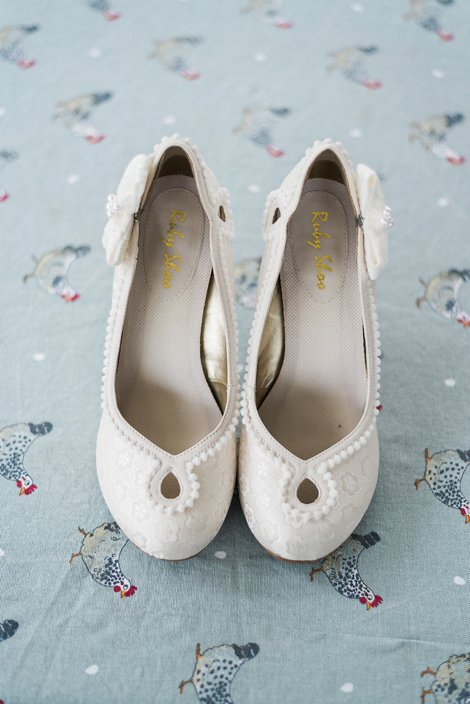 Bridal shoes on blue tablecloth