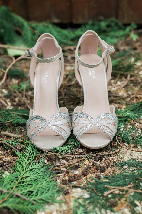 Bridal shoes on the ground outside