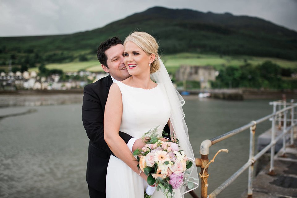 Bride and groom on the pier in Carlingford