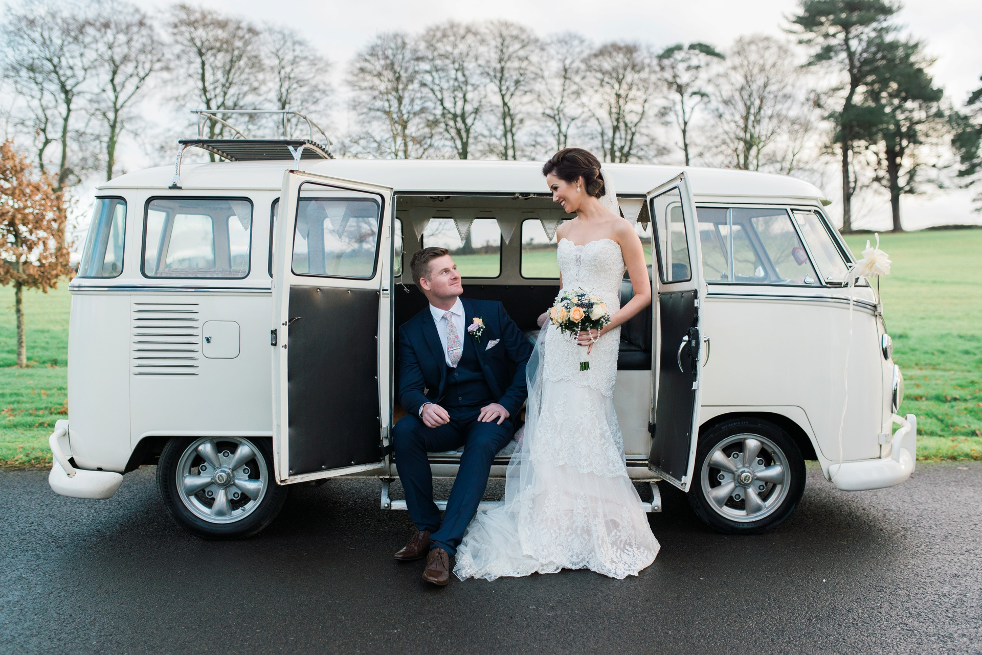 Bride and groom with white Volkswagon