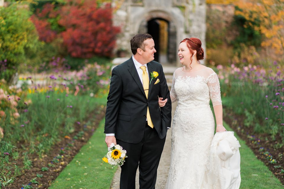 Bride and groom in Dromoland Castle garden laughing