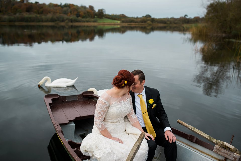 Dromoland Castle bride and groom in boat on lake