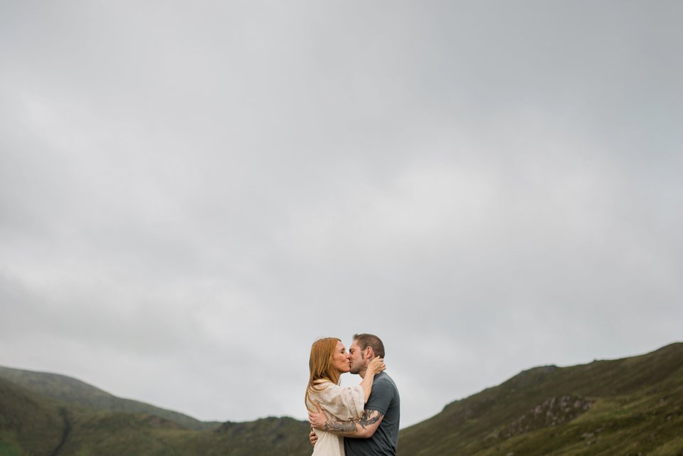 Man and woman kissing up the kerry mountains