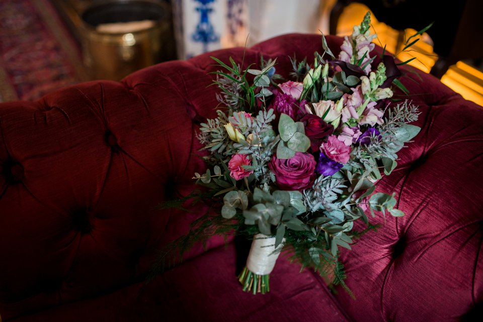 Wedding bouquet on a red couch in Tinakilly House