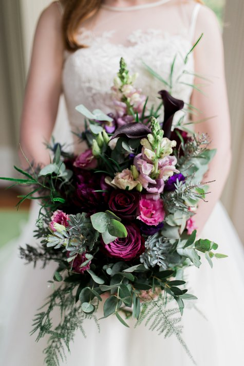 Wedding bouquet with pink and purple flowers in Tinakilly House