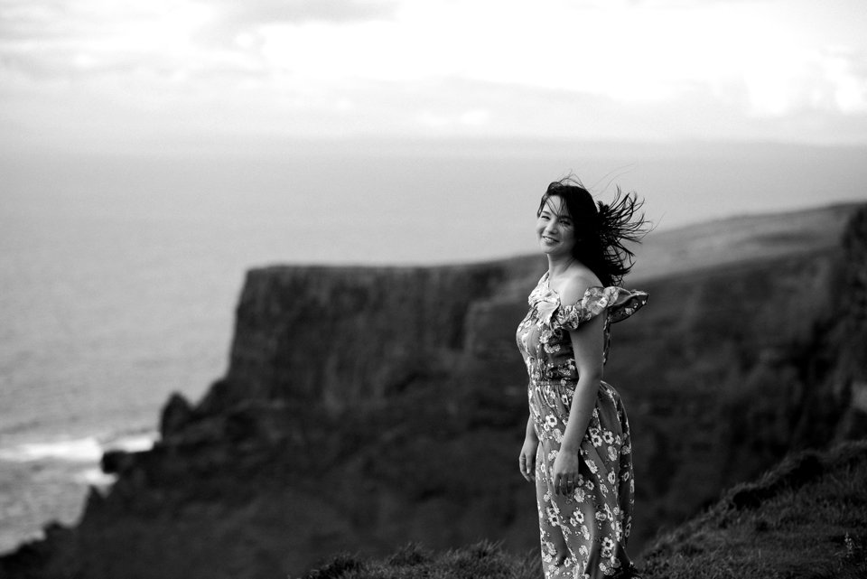 Girl at cliffs of moher in black and white