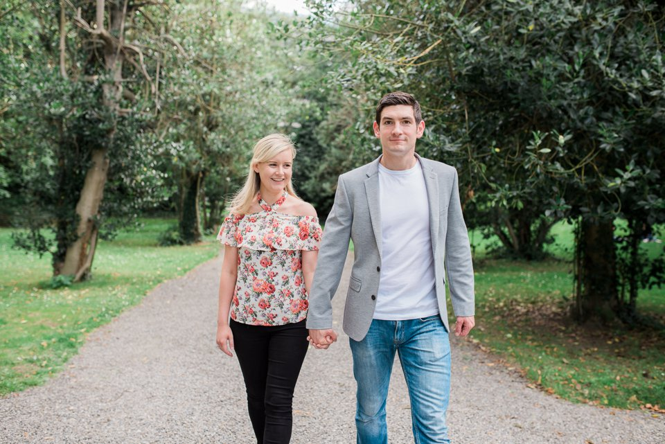 Young couple walking through Iveagh Gardens