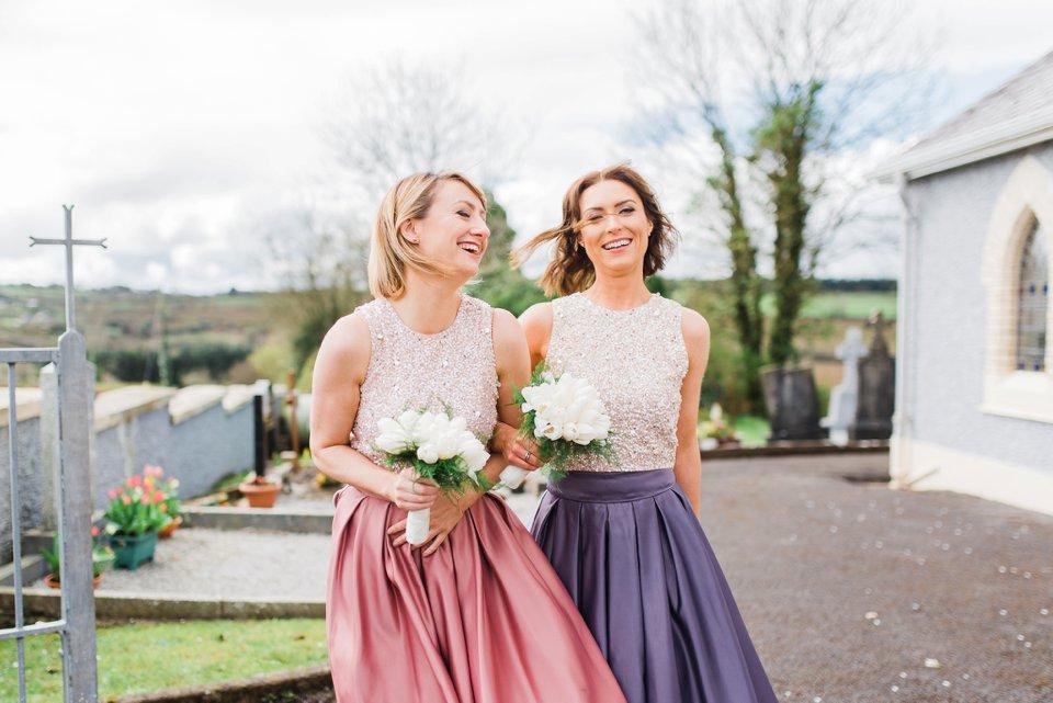 Bridesmaids laughing at church