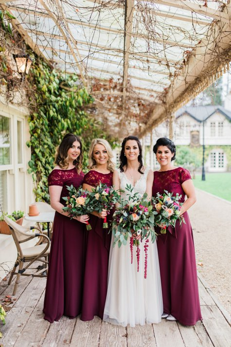 Bride with bridesmaids in burgundy dresses