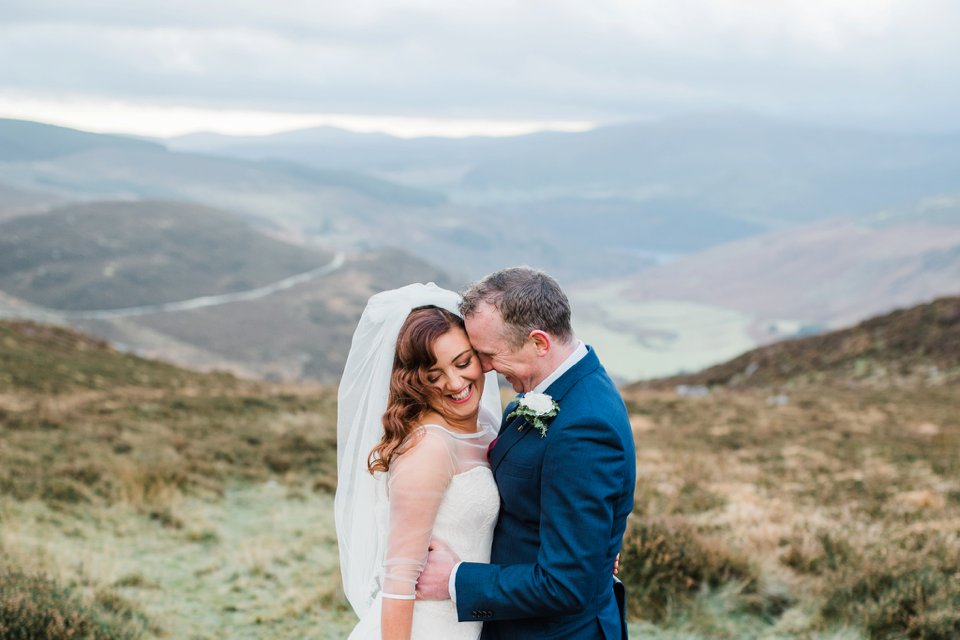 Bride and groom in Ireland mountains