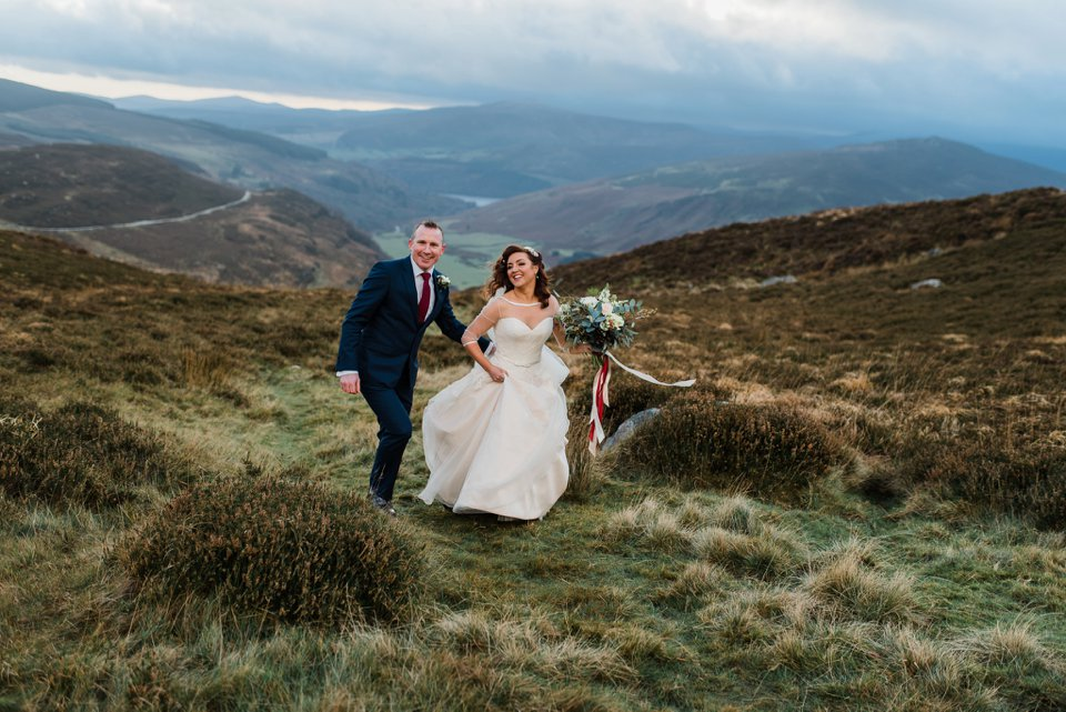 Bride and groom walking in Wicklow mountains