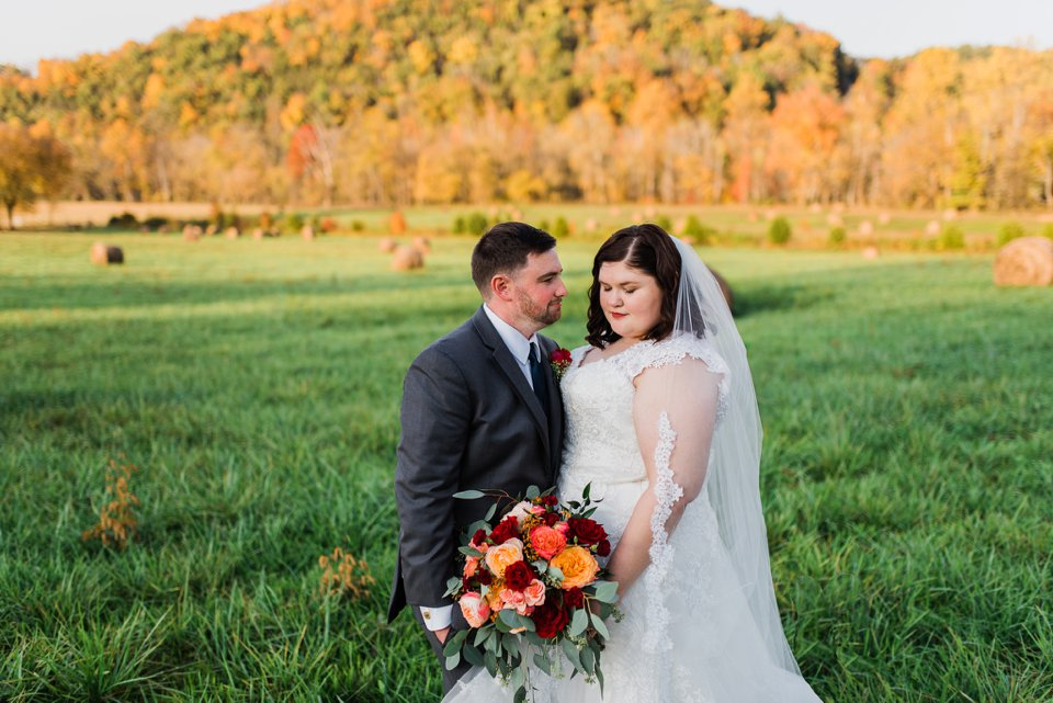 Bride and groom with hay bales in Tennessee