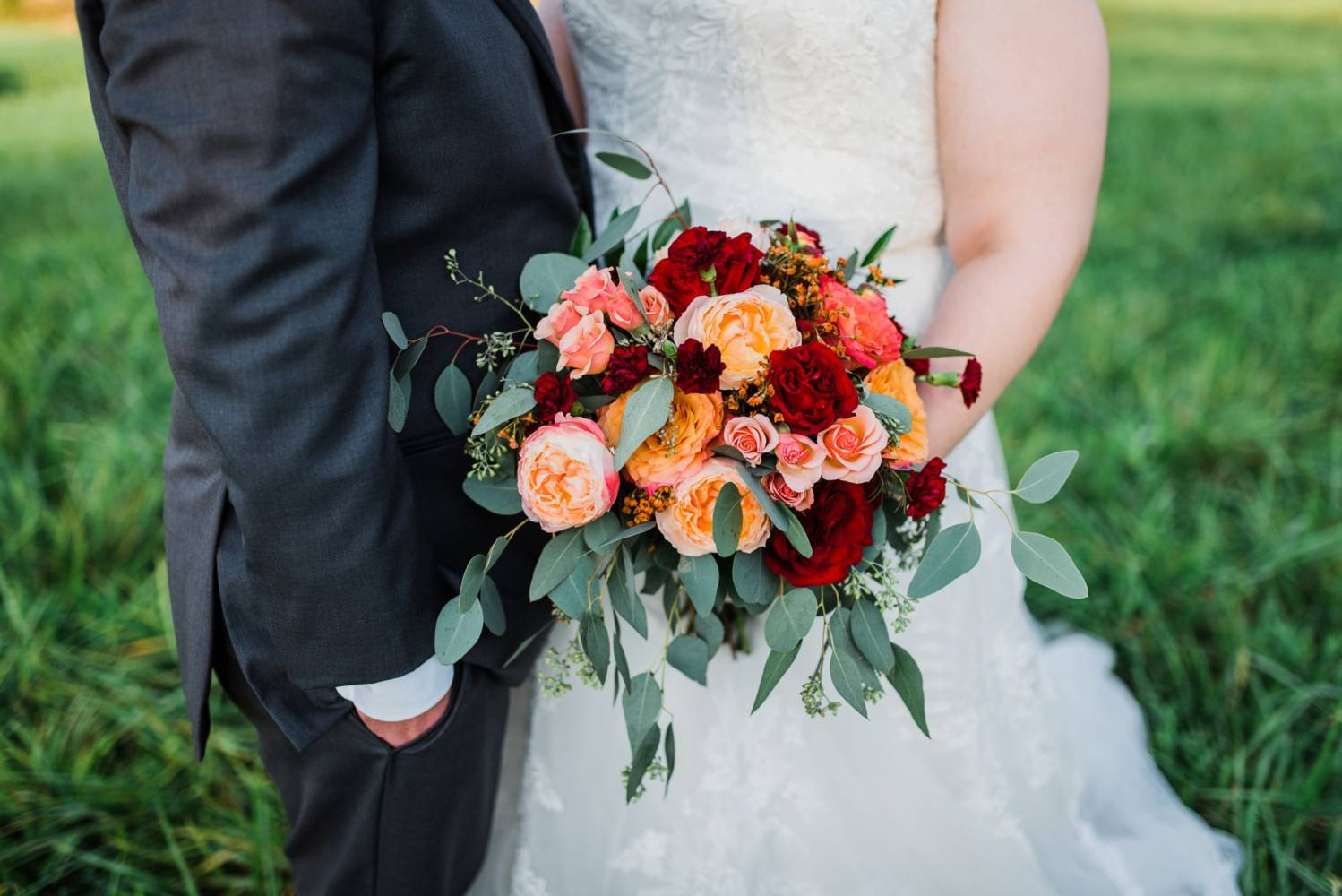 Autumn wedding red orange peach bouquet