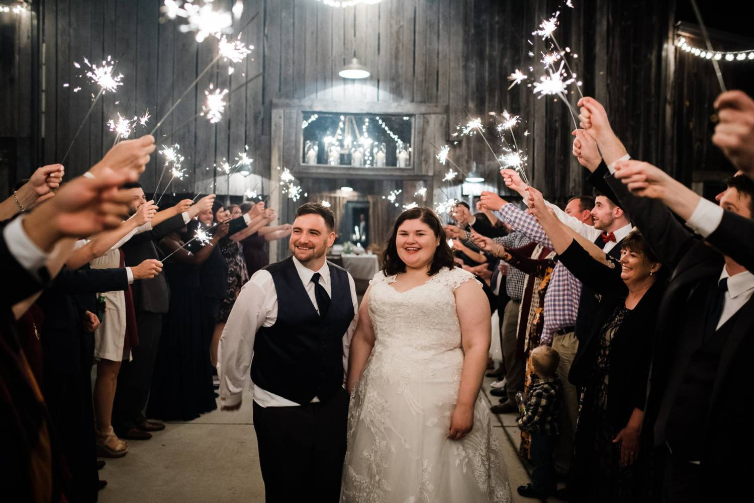 Barn wedding bride and groom sparkler exit
