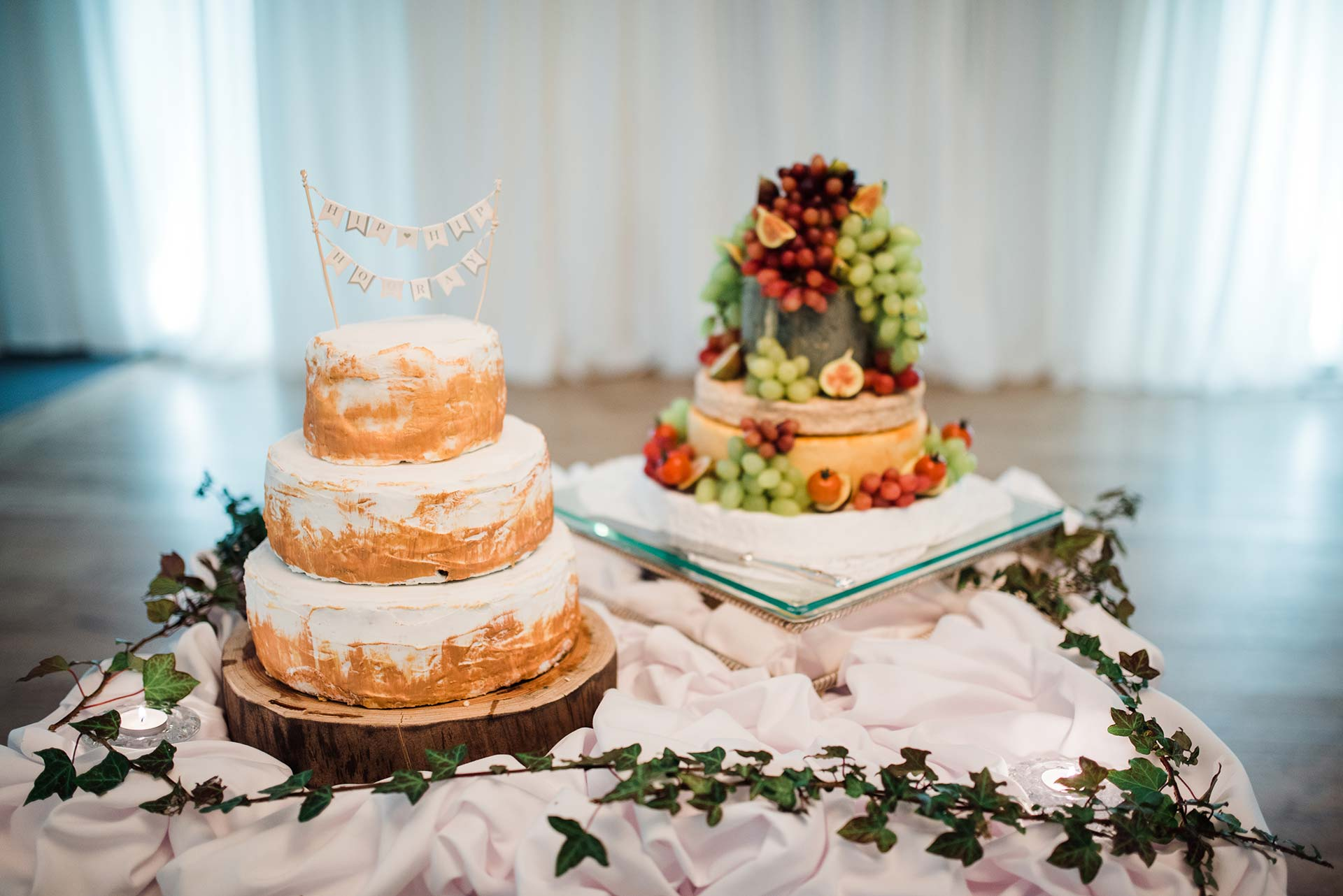 homemade naked wedding cake with bunting