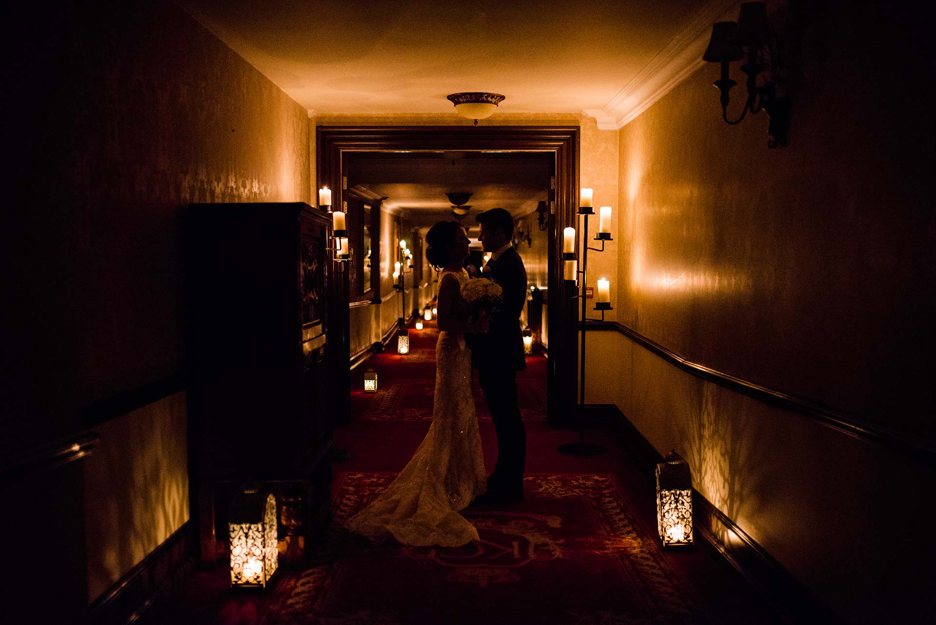 candlelit silhouette of couple in hallway