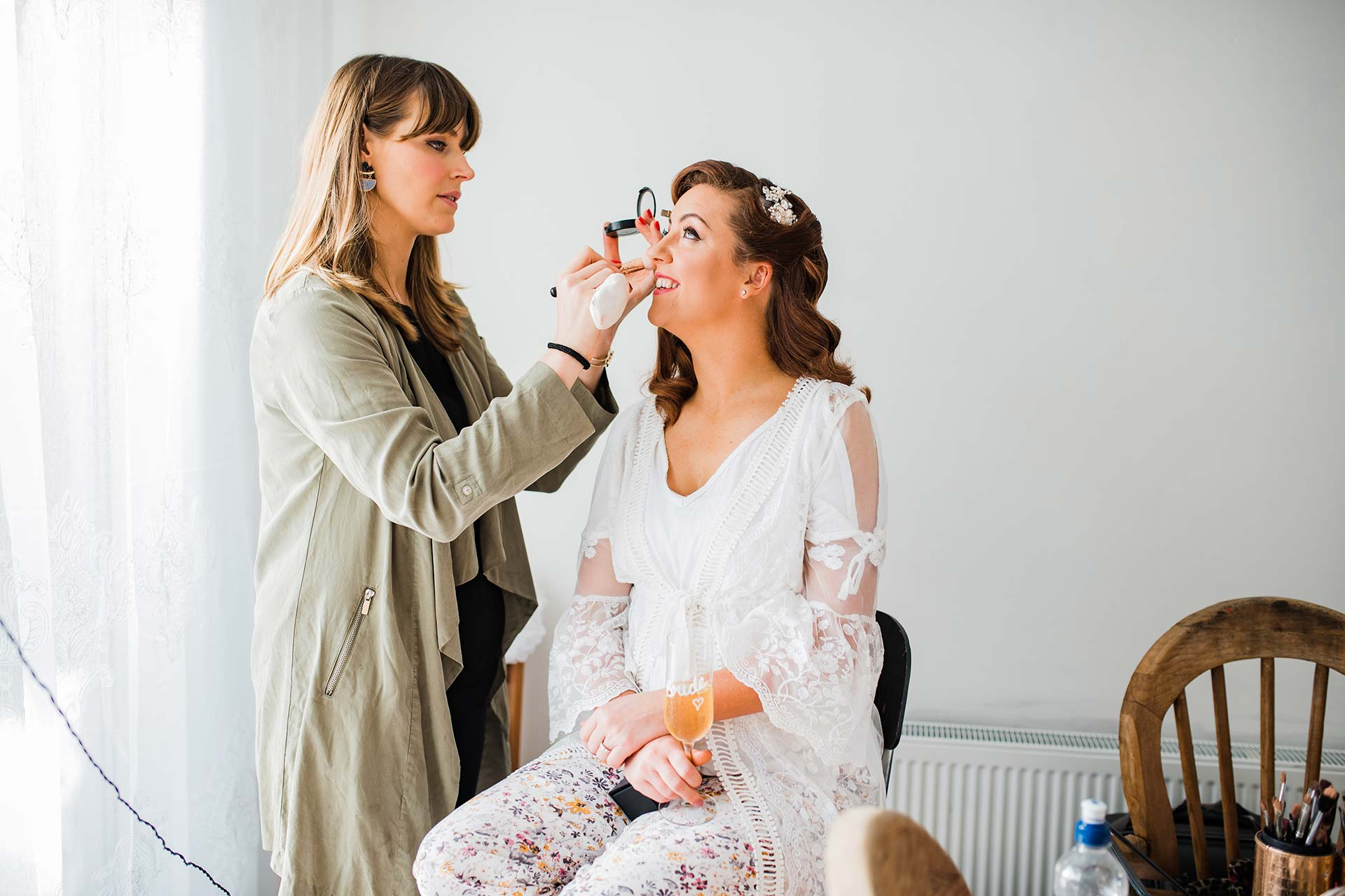 makeup artists touches up brides makeup