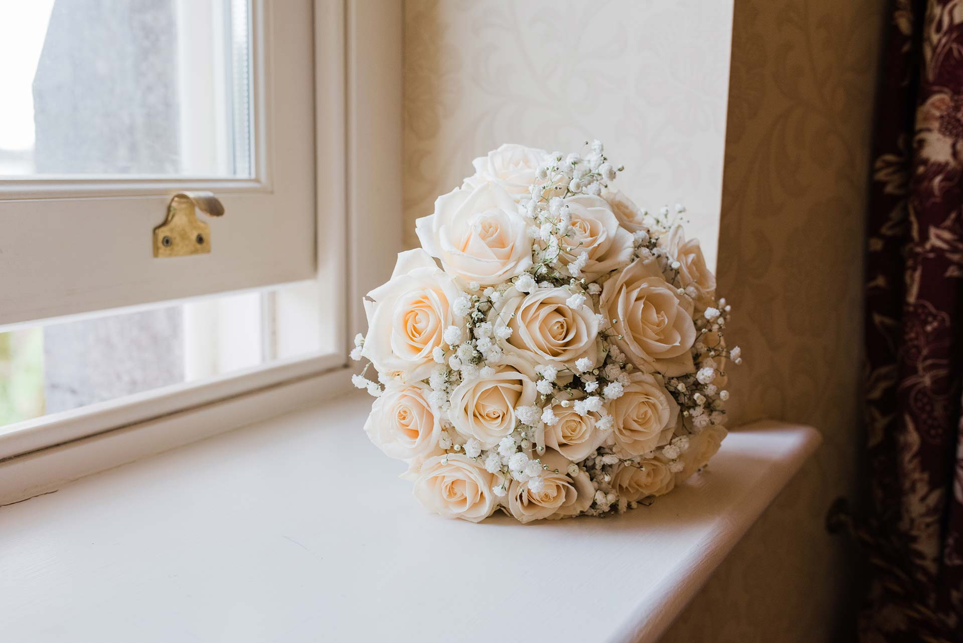 white rose and baby's breath wedding bouquet
