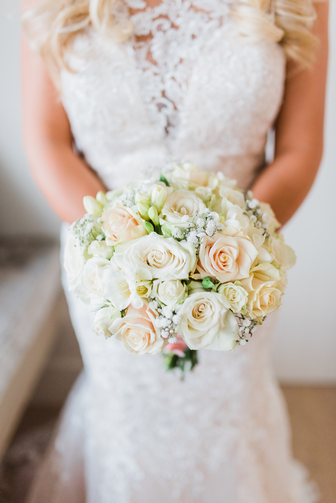 Wedding bouquet of white and cream roses