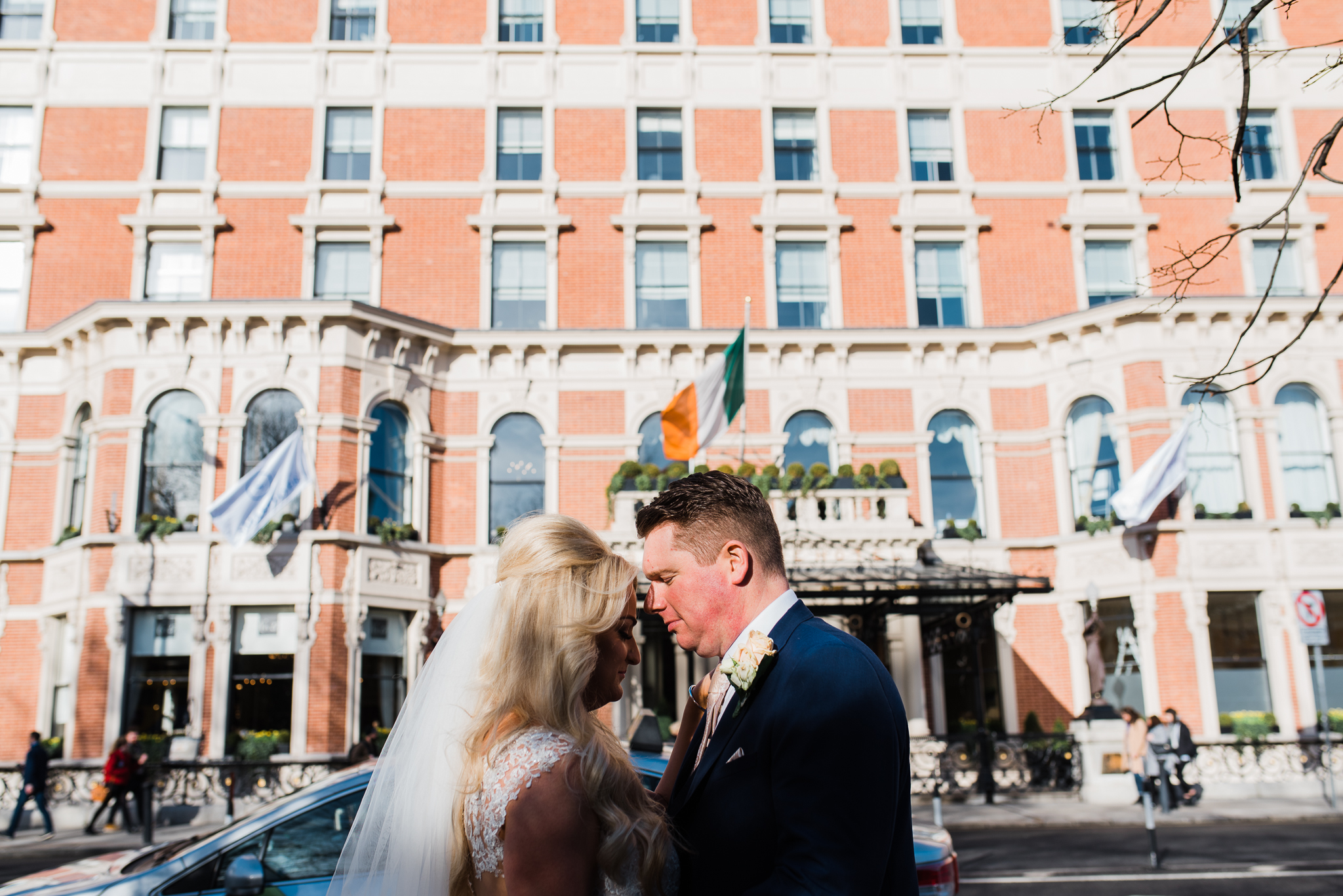 Bride and groom outside the Shelbourne Hotel in Dublin