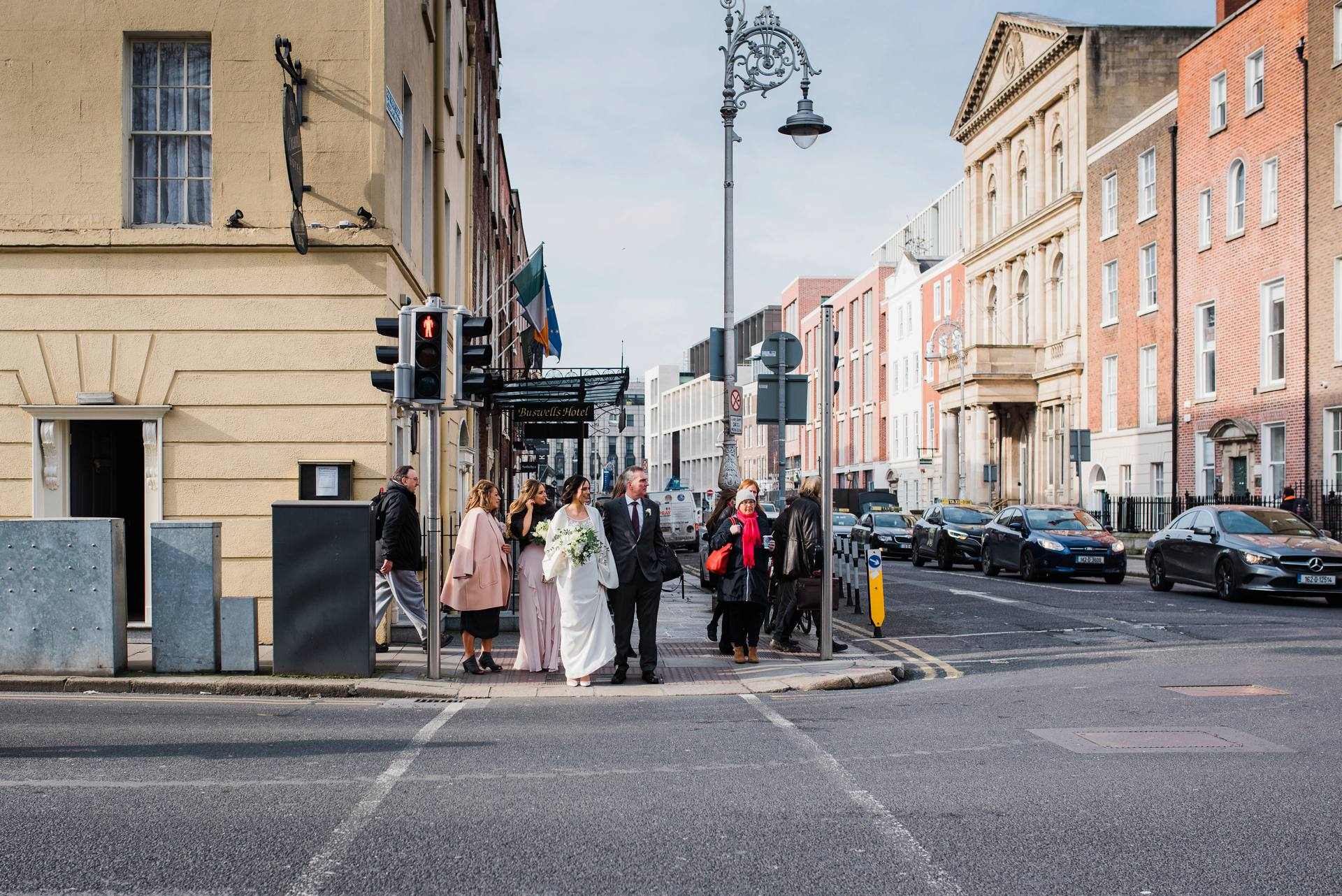 Bridal party waiting at traffic lights in Dublin