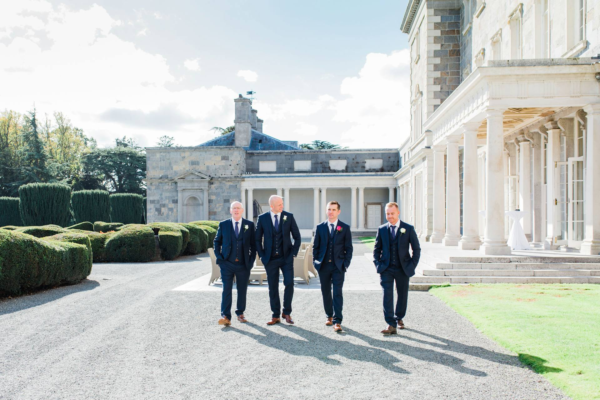 Groom and groomsmen walking in Carton House