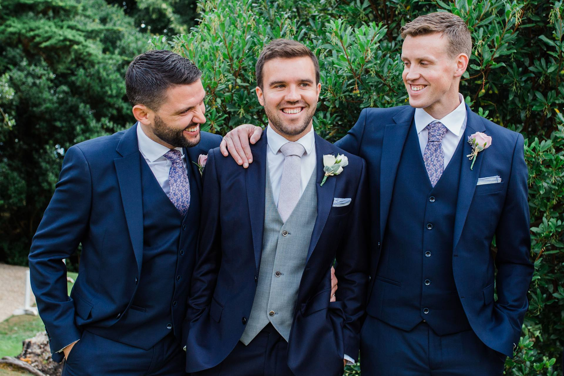 Groom laughing with groomsmen in Tinakilly House gardens