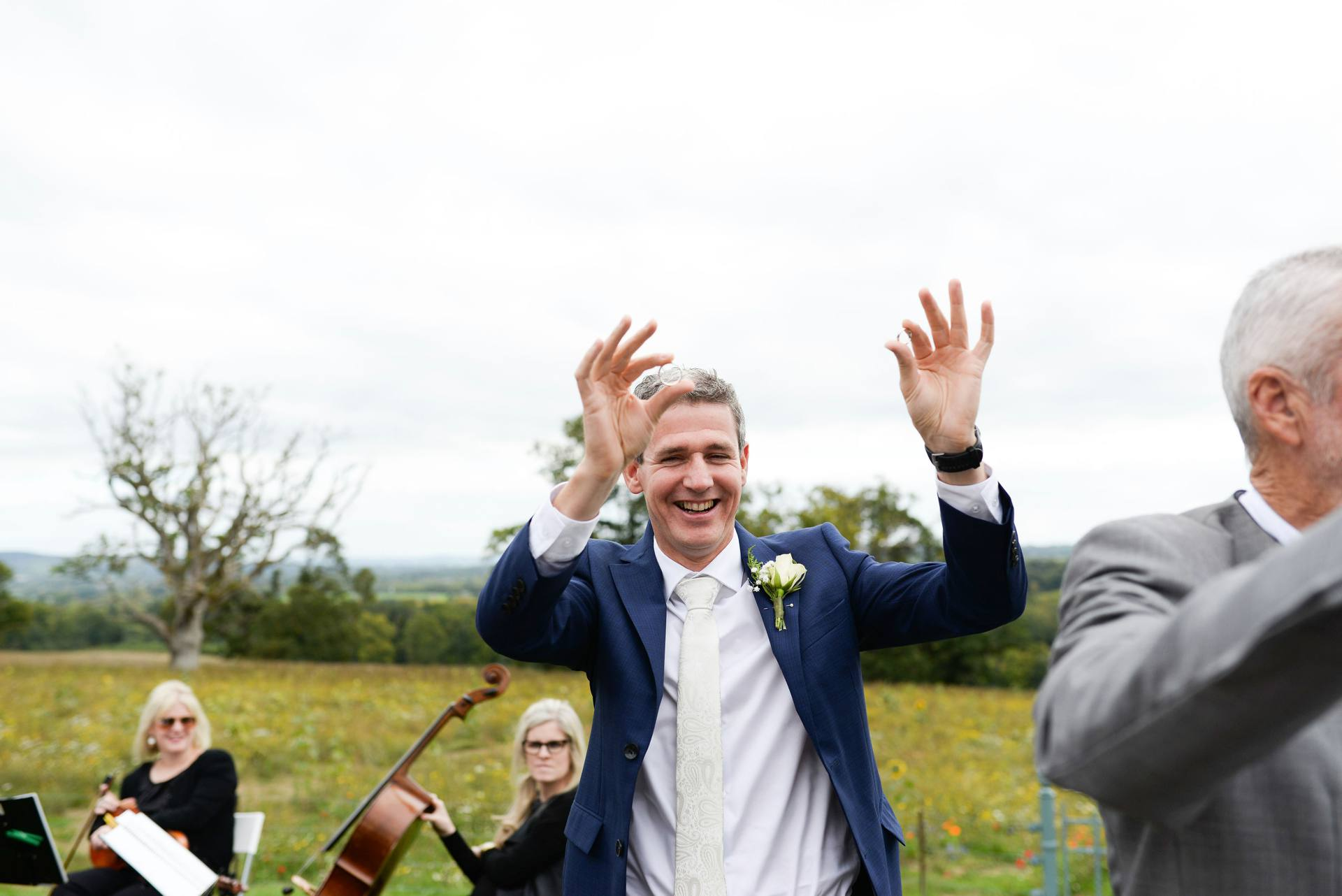 Best man holding up the wedding rings
