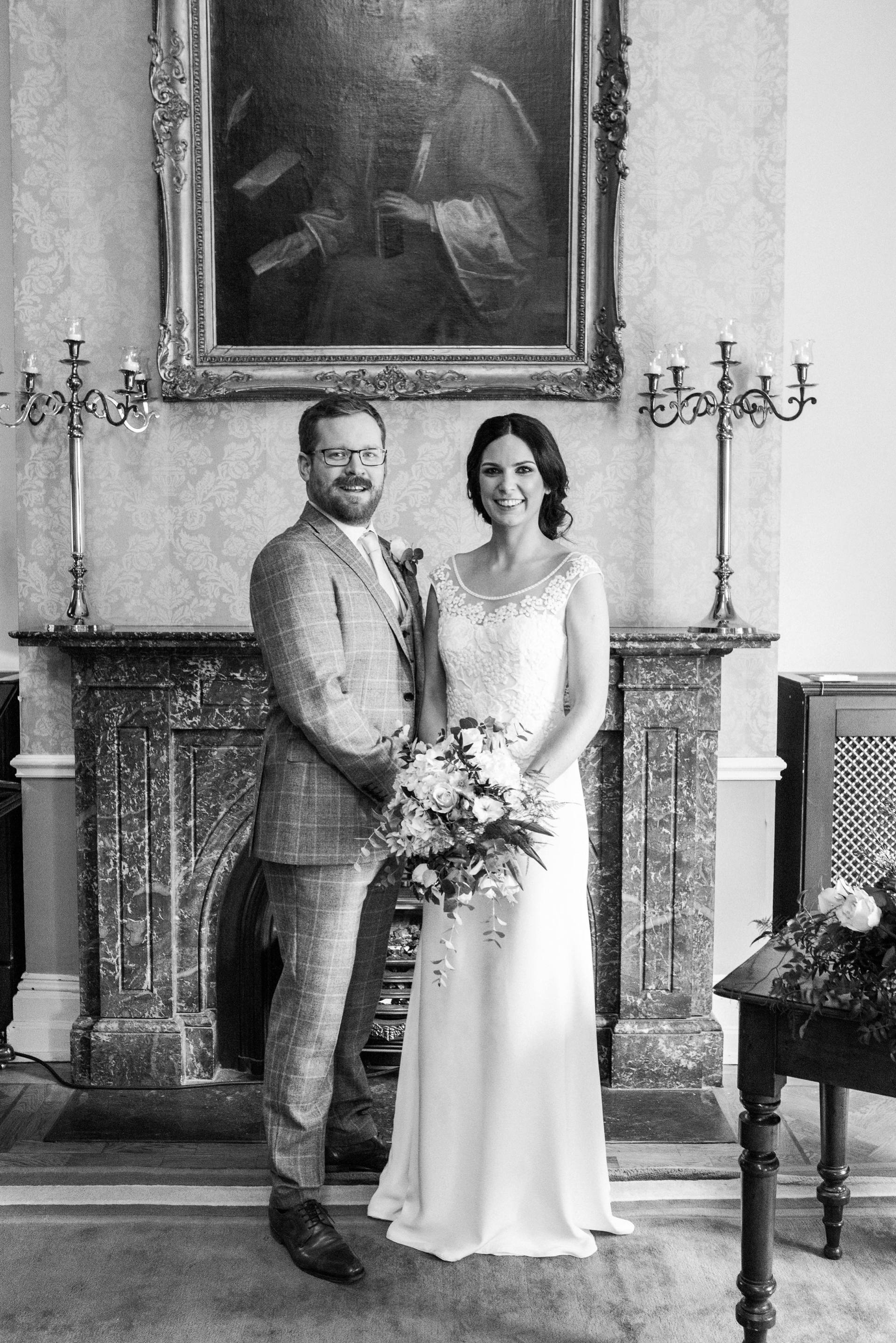Portrait of Bride and groom in front of mantlepiece
