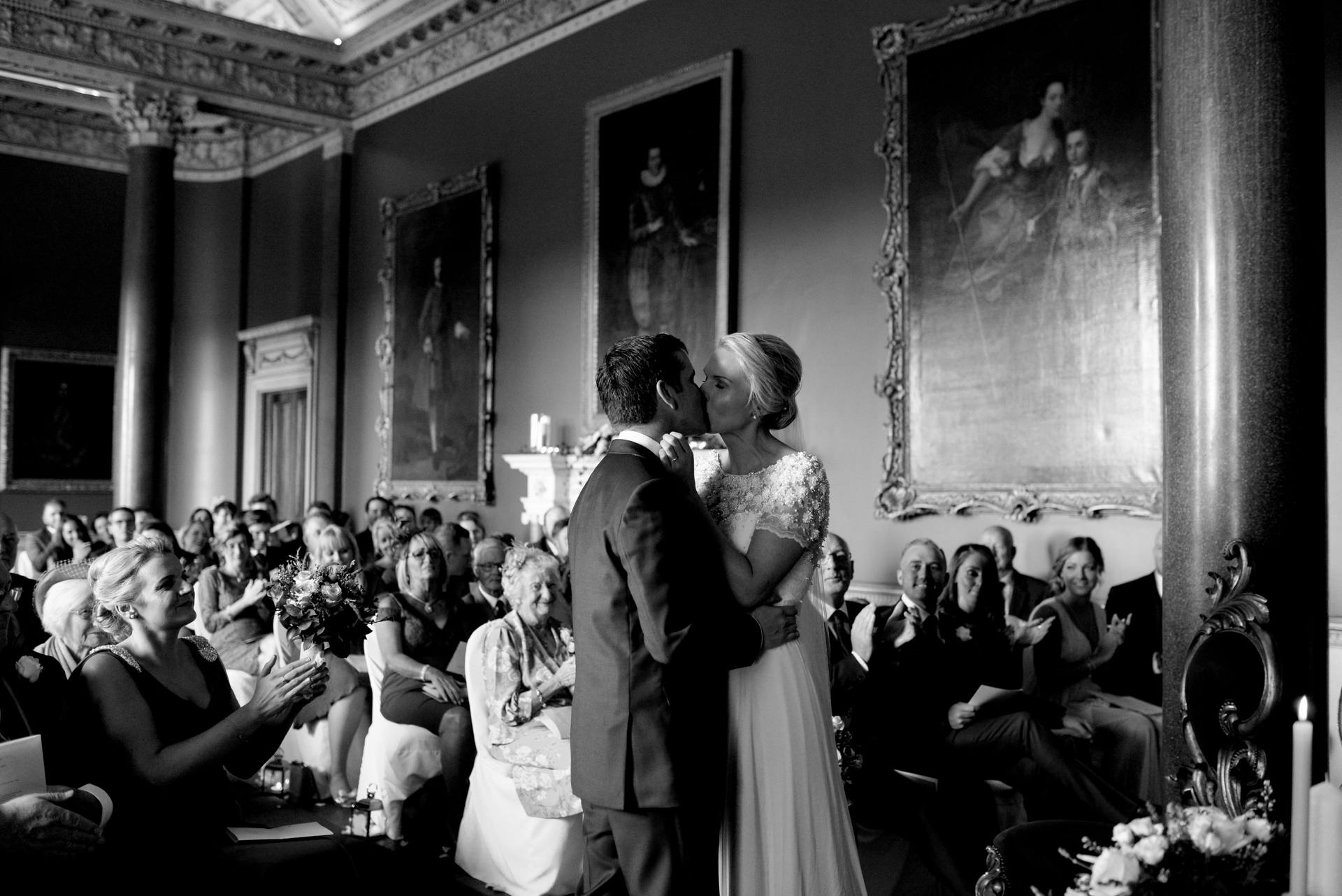 Bride and groom kissing in Carton House