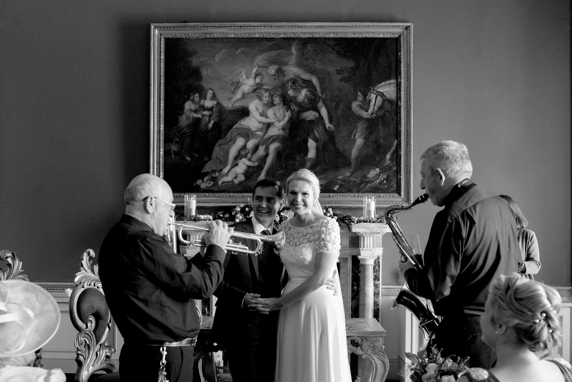 Trumpet and saxophone serenading bride and groom in Carton House