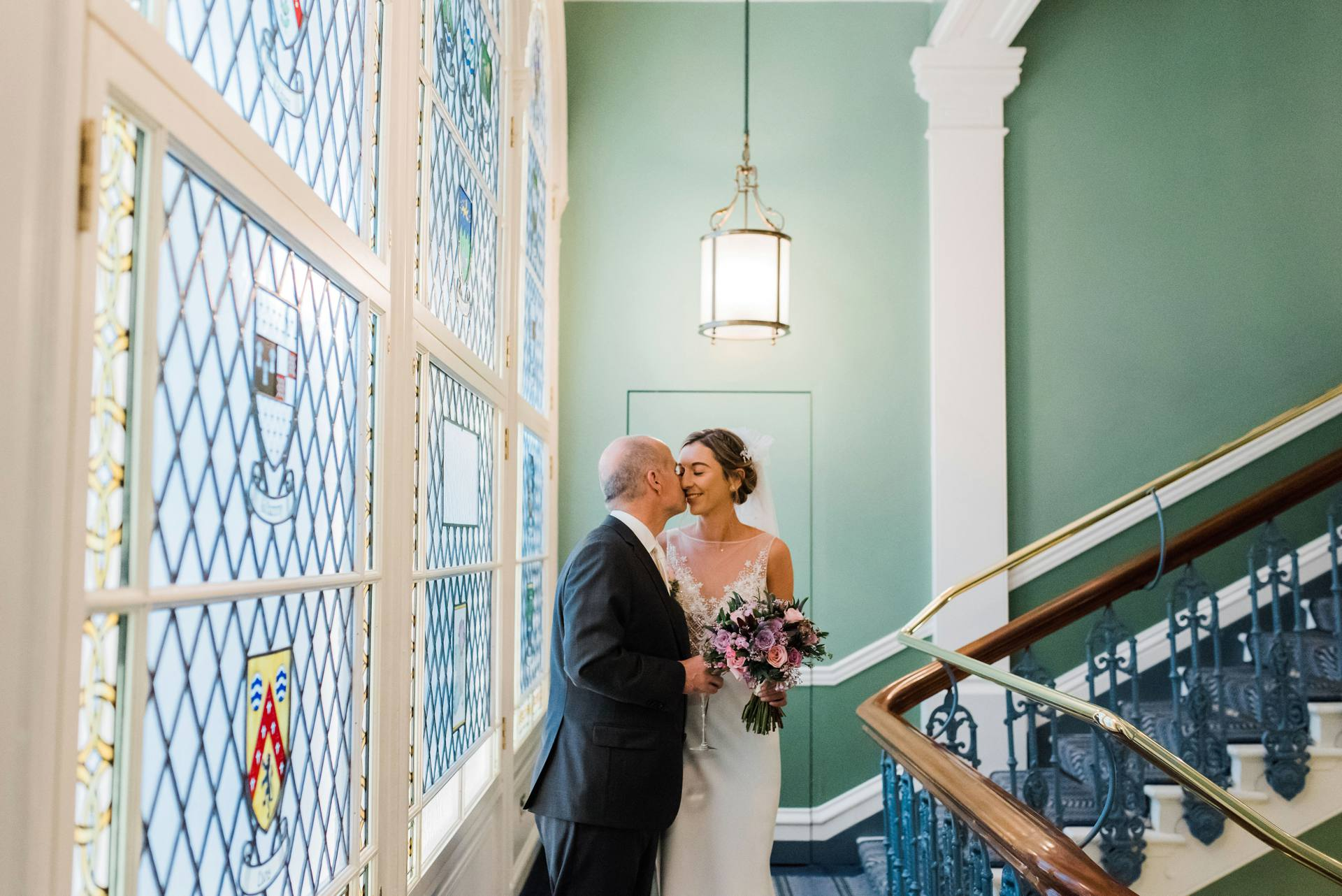 Bride and groom kissing in the Shelbourne Hotel Dublin