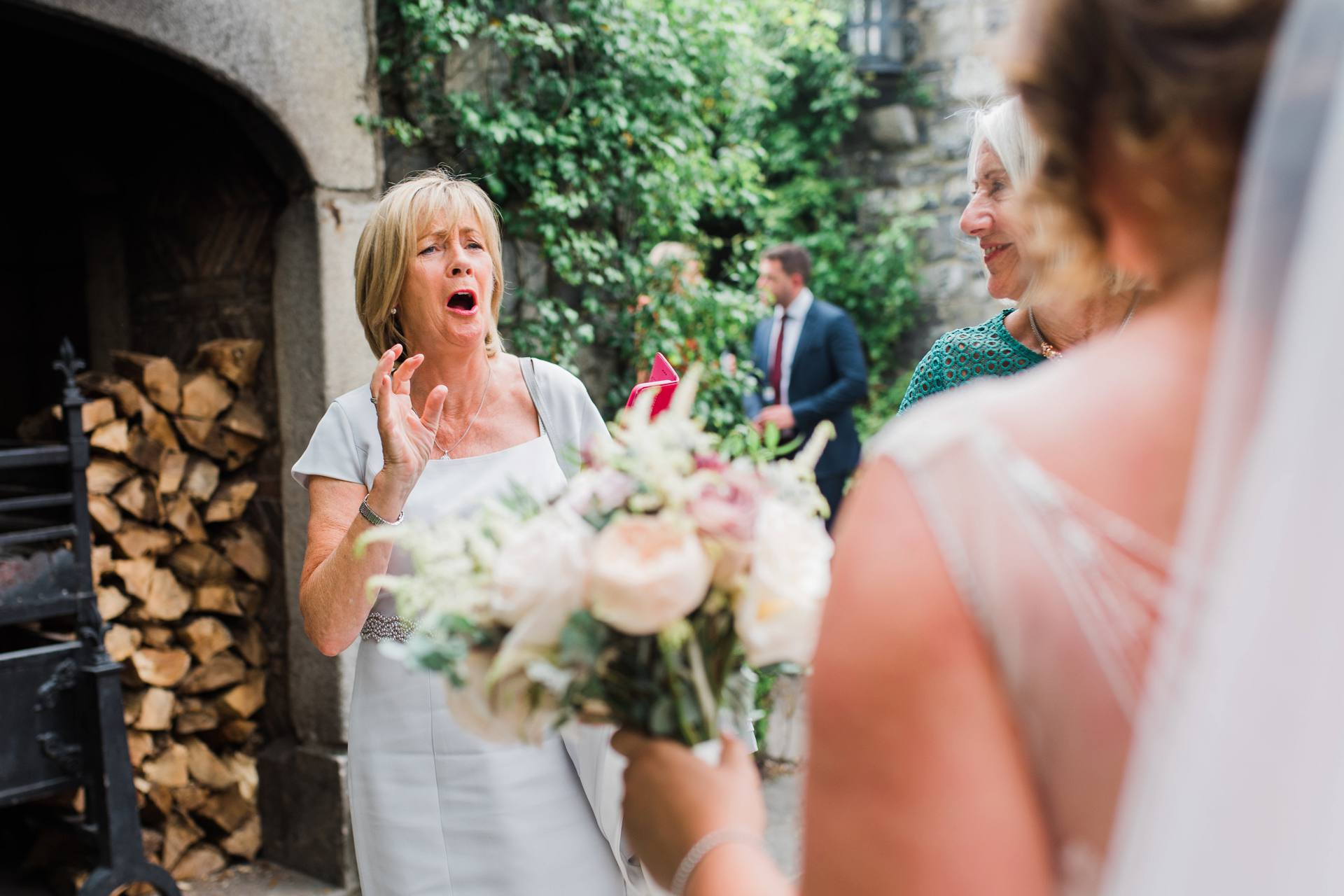 A guest exclaiming in surprise when she sees the bride