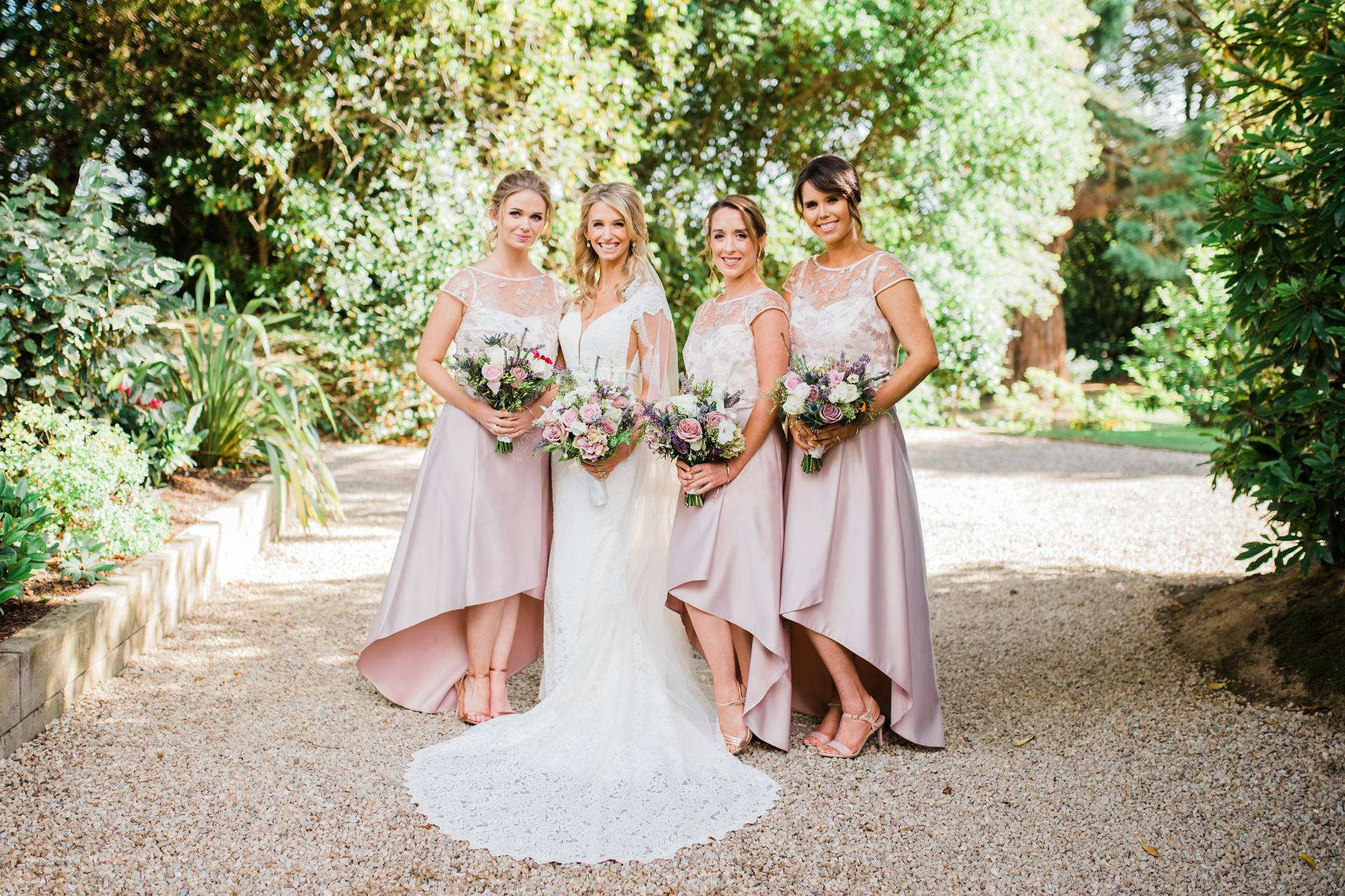 Bride with her three bridesmaids in pink dresses in Tinakilly House