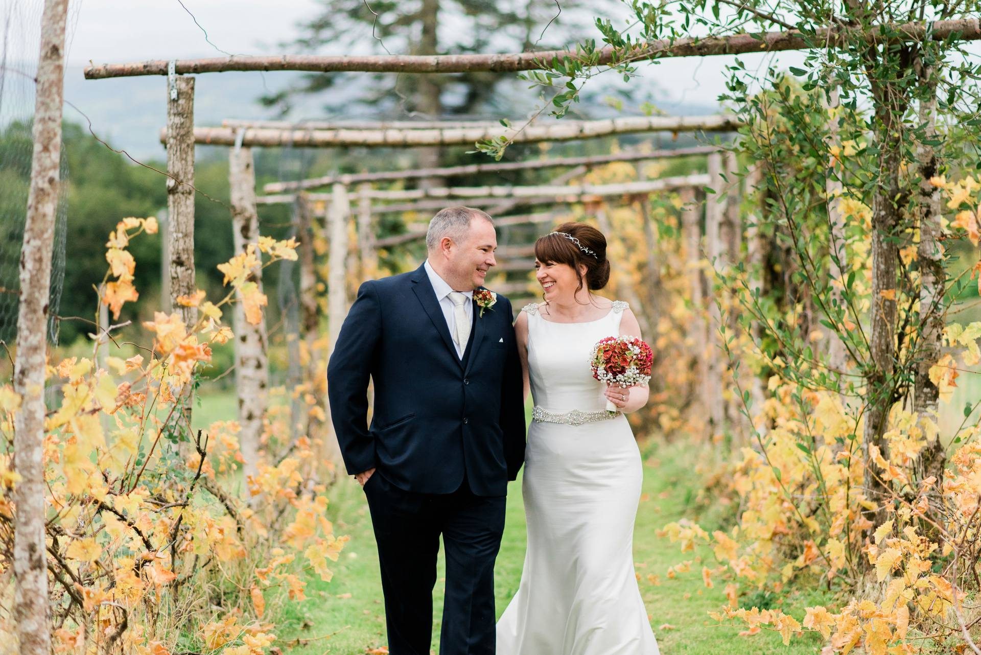 Bride and groom laughing together in Longueville House