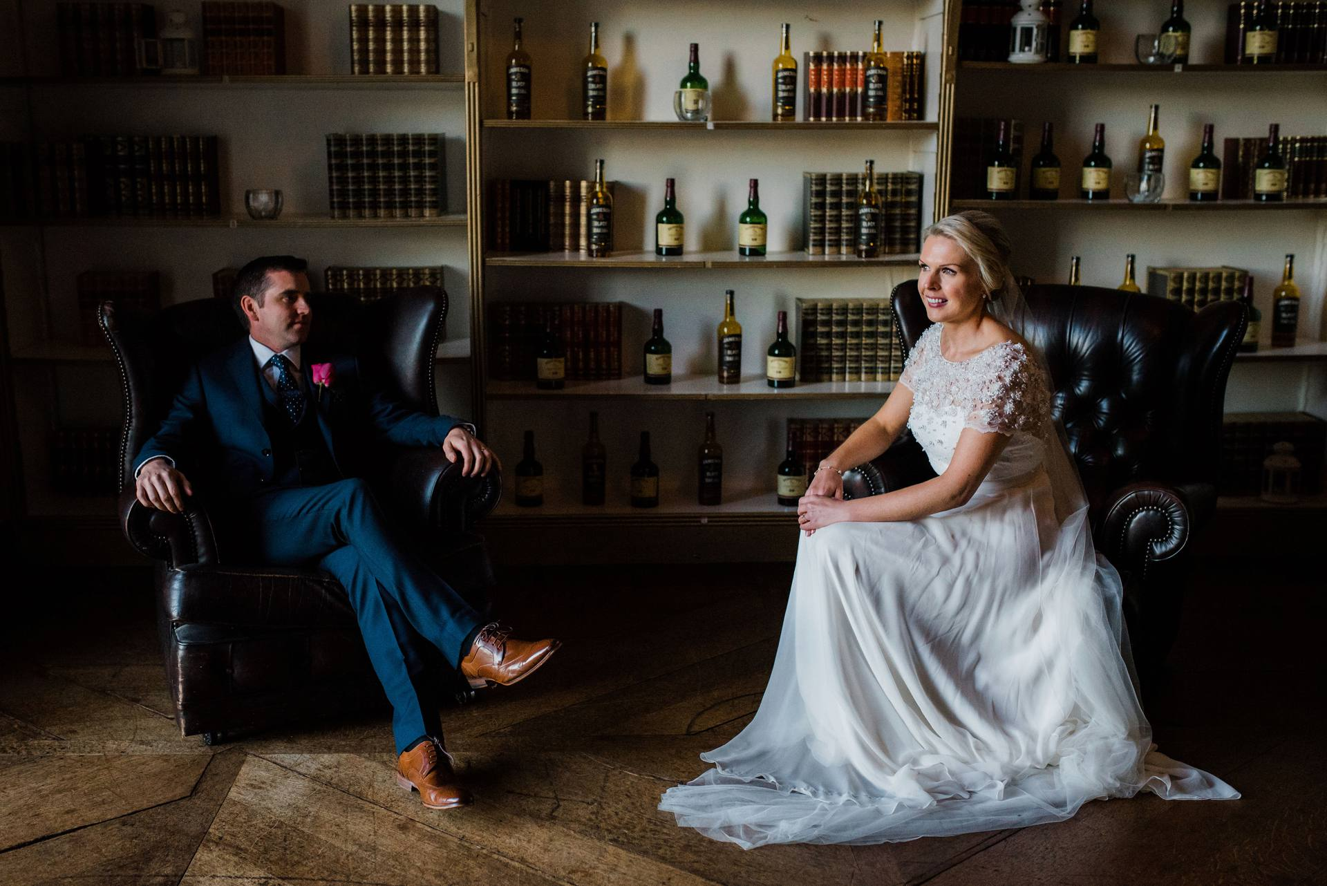 Bride and groom sitting together in the whiskey room at Carton House