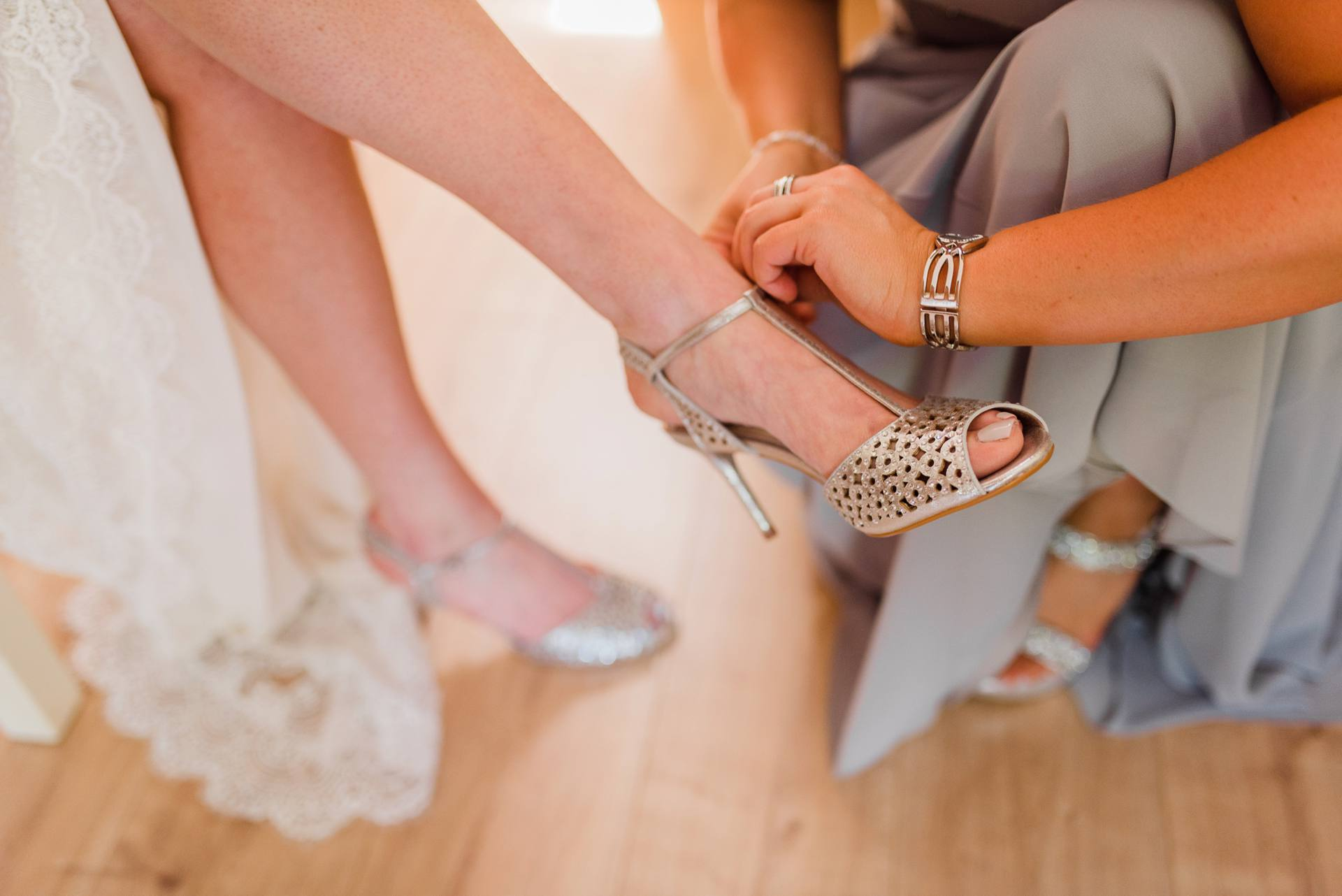 Jenny Packham shoes being put on bride