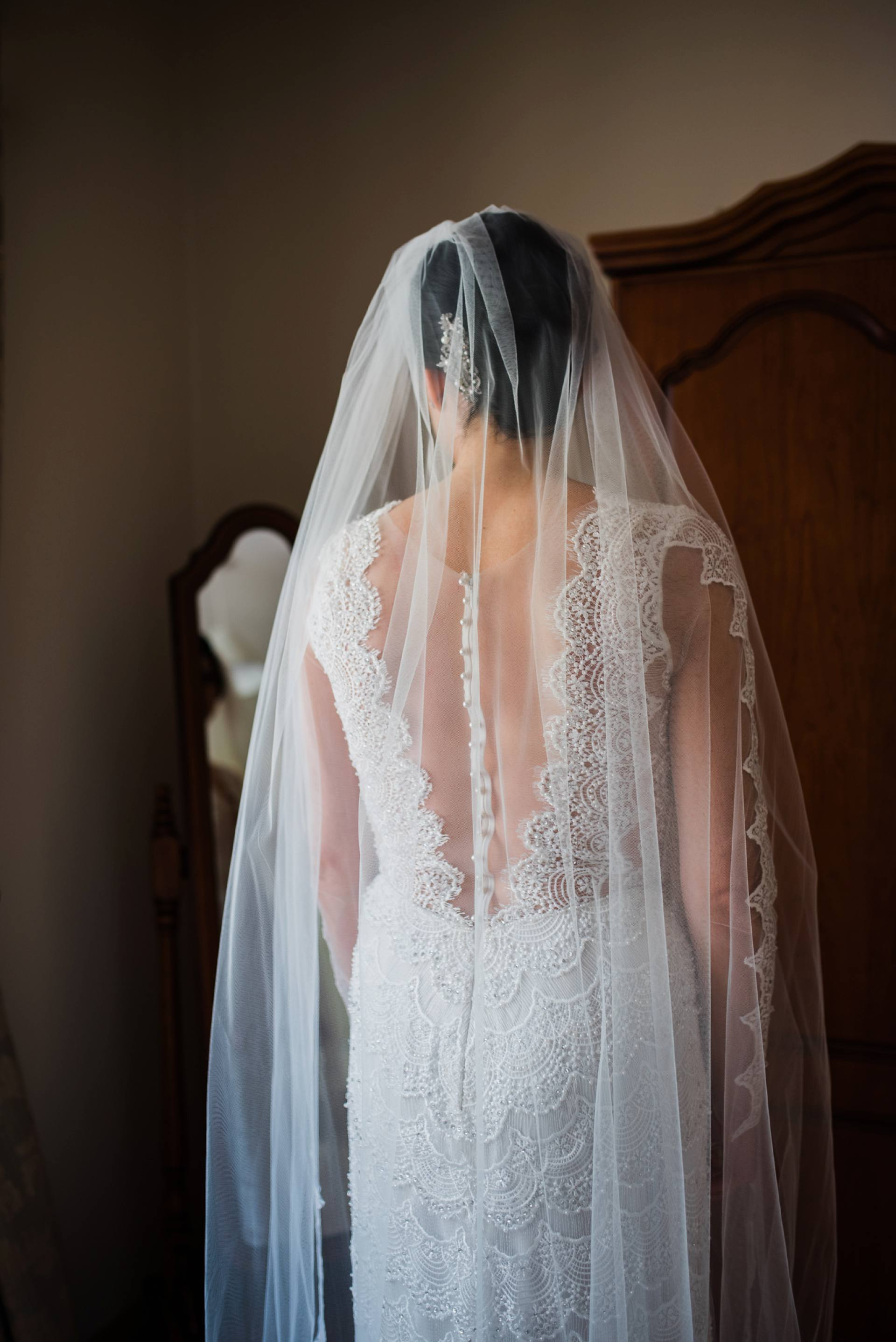 Lace detail on the back of wedding dress
