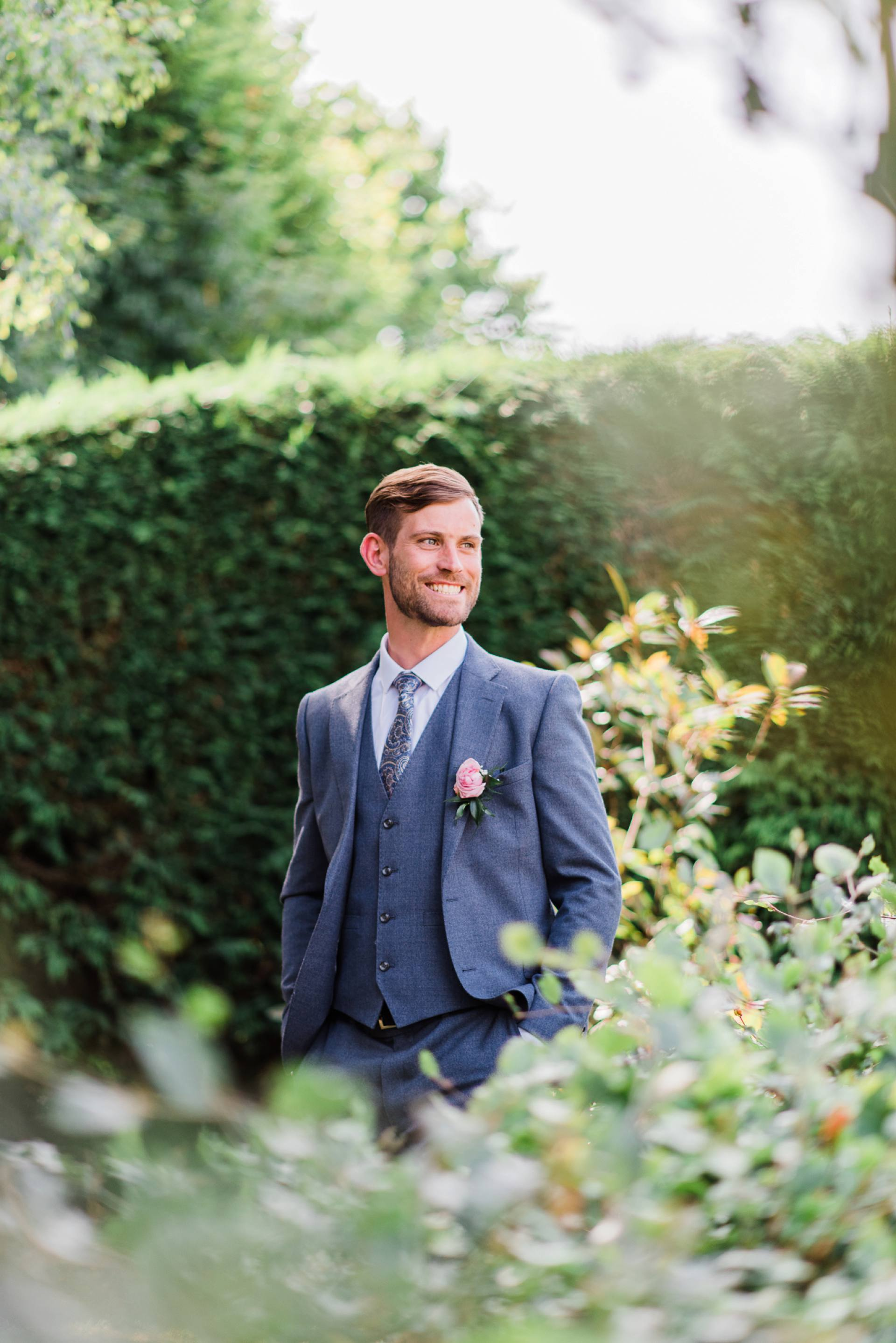Groom laughing in the sun