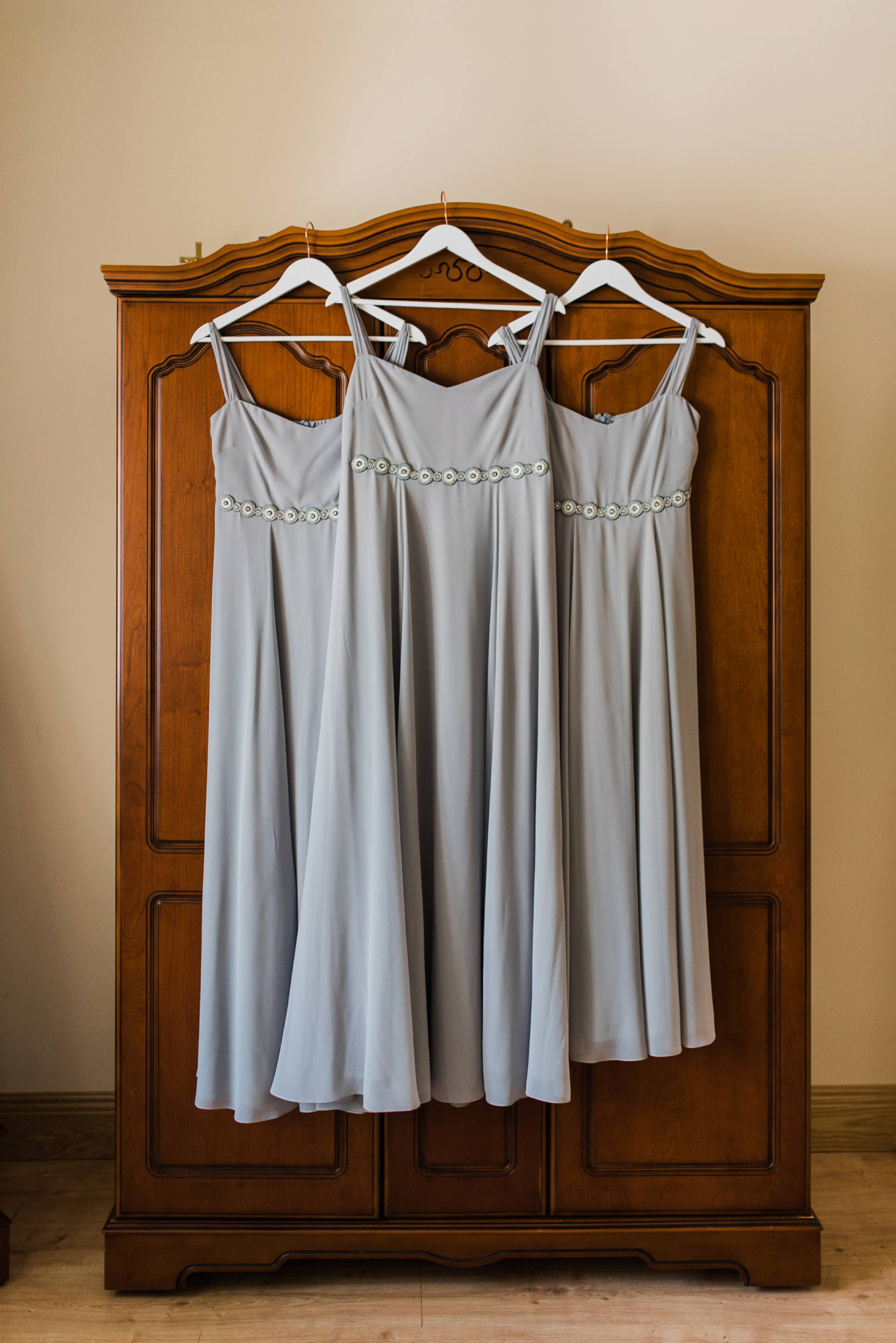 Grey bridesmaids dresses hanging up