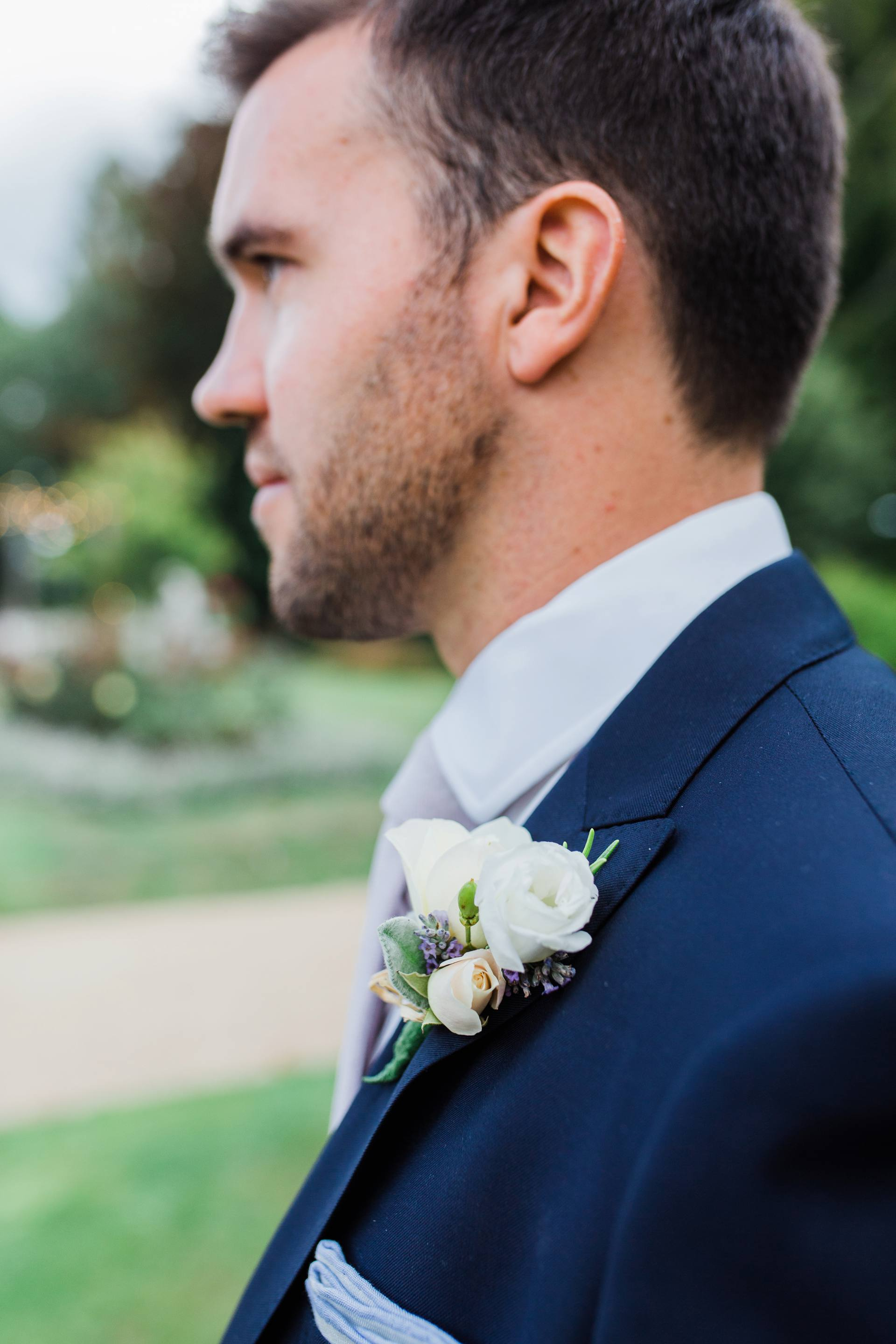 Portrait of groom and flower detail