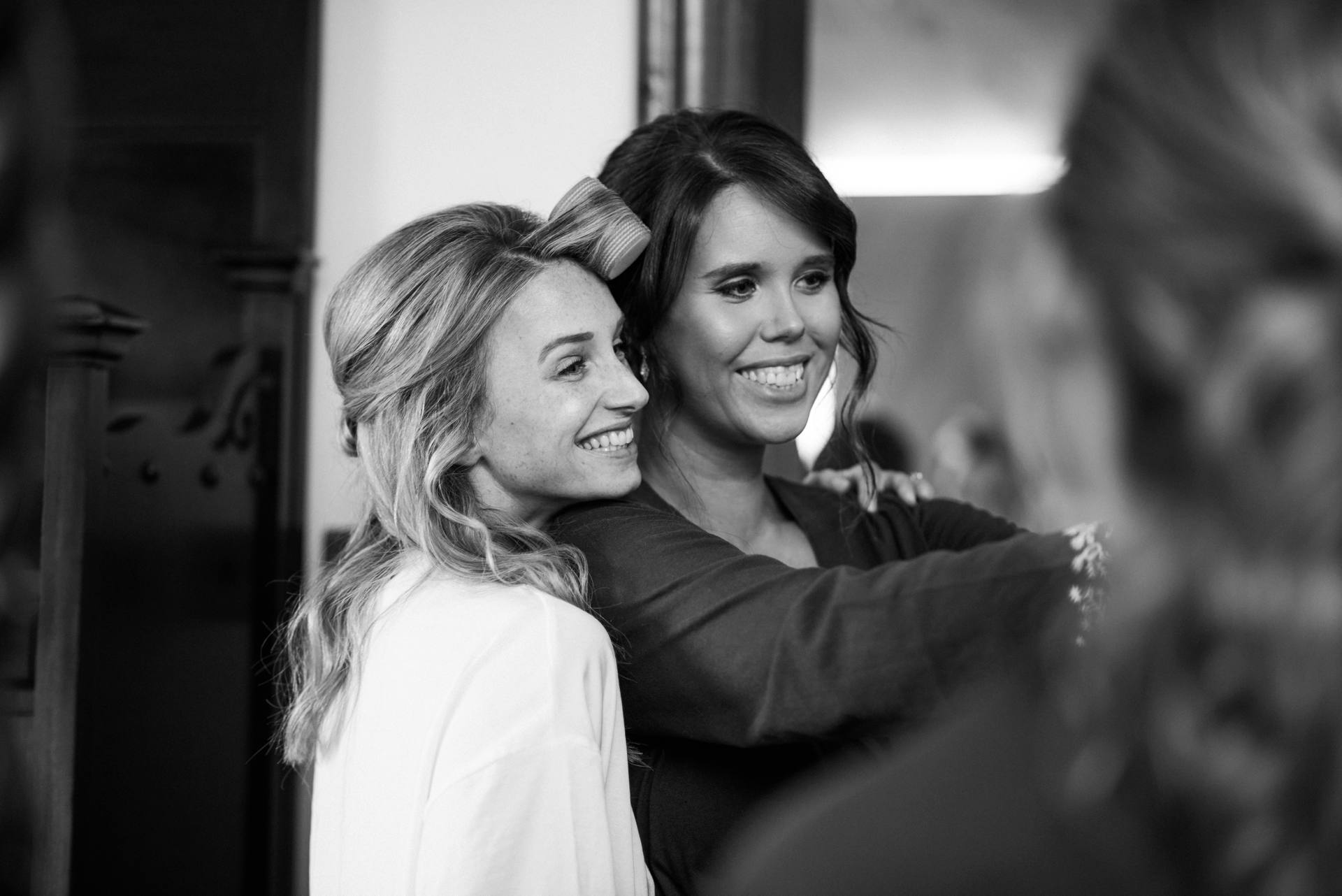 Candid shot of bride and bridesmaid