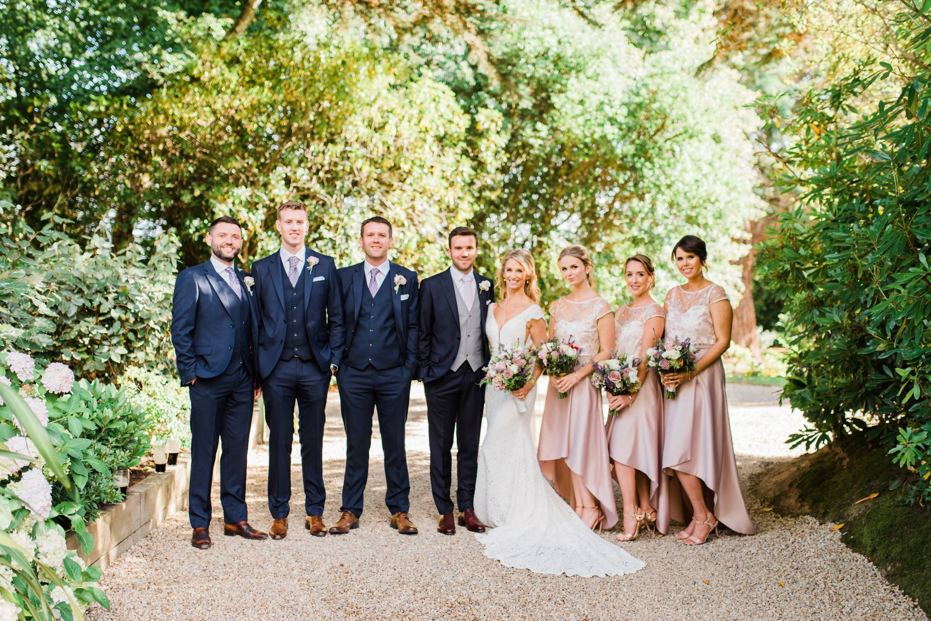 Groomsmen and bridesmaids standing together