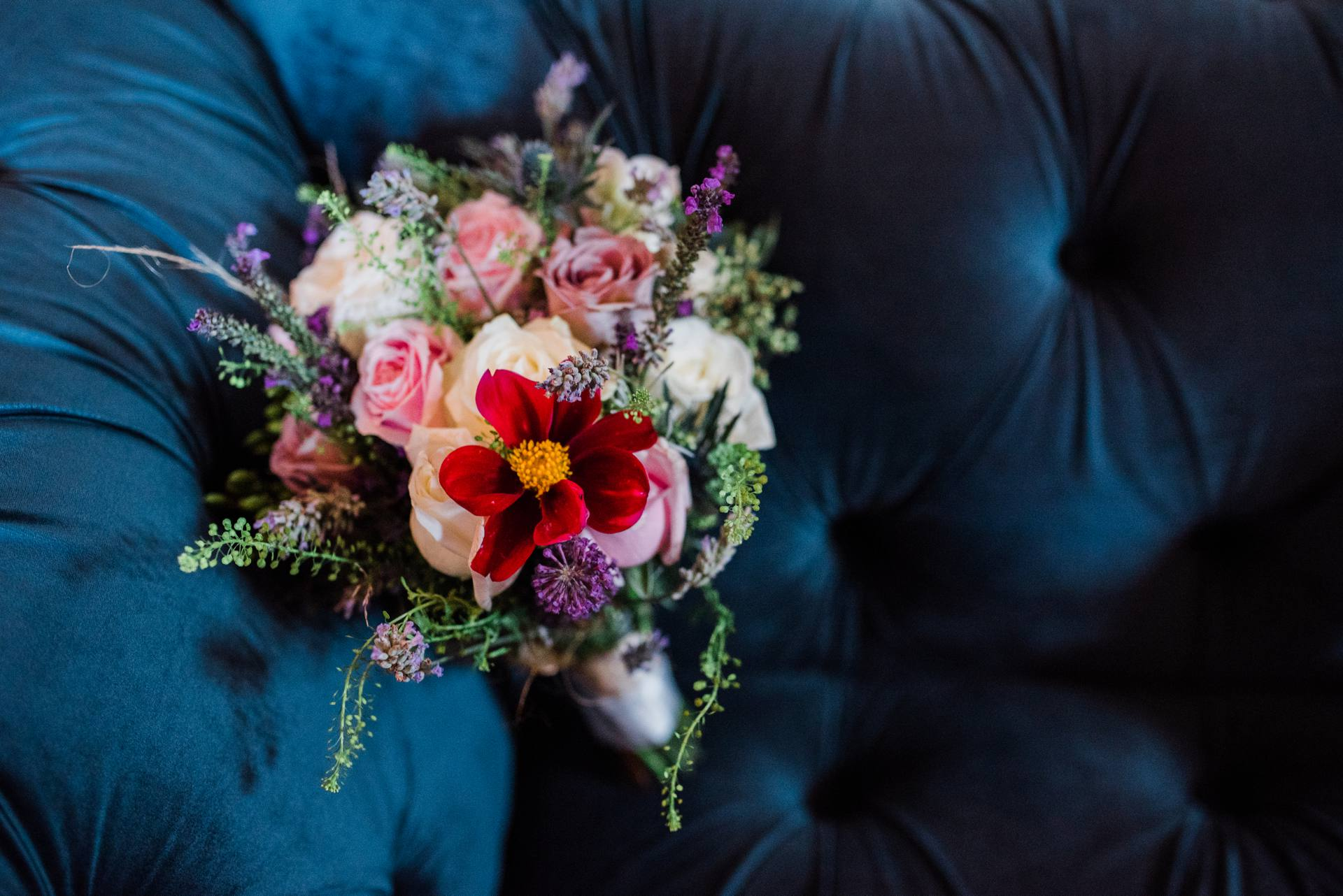 Bridesmaids flowers on blue couch