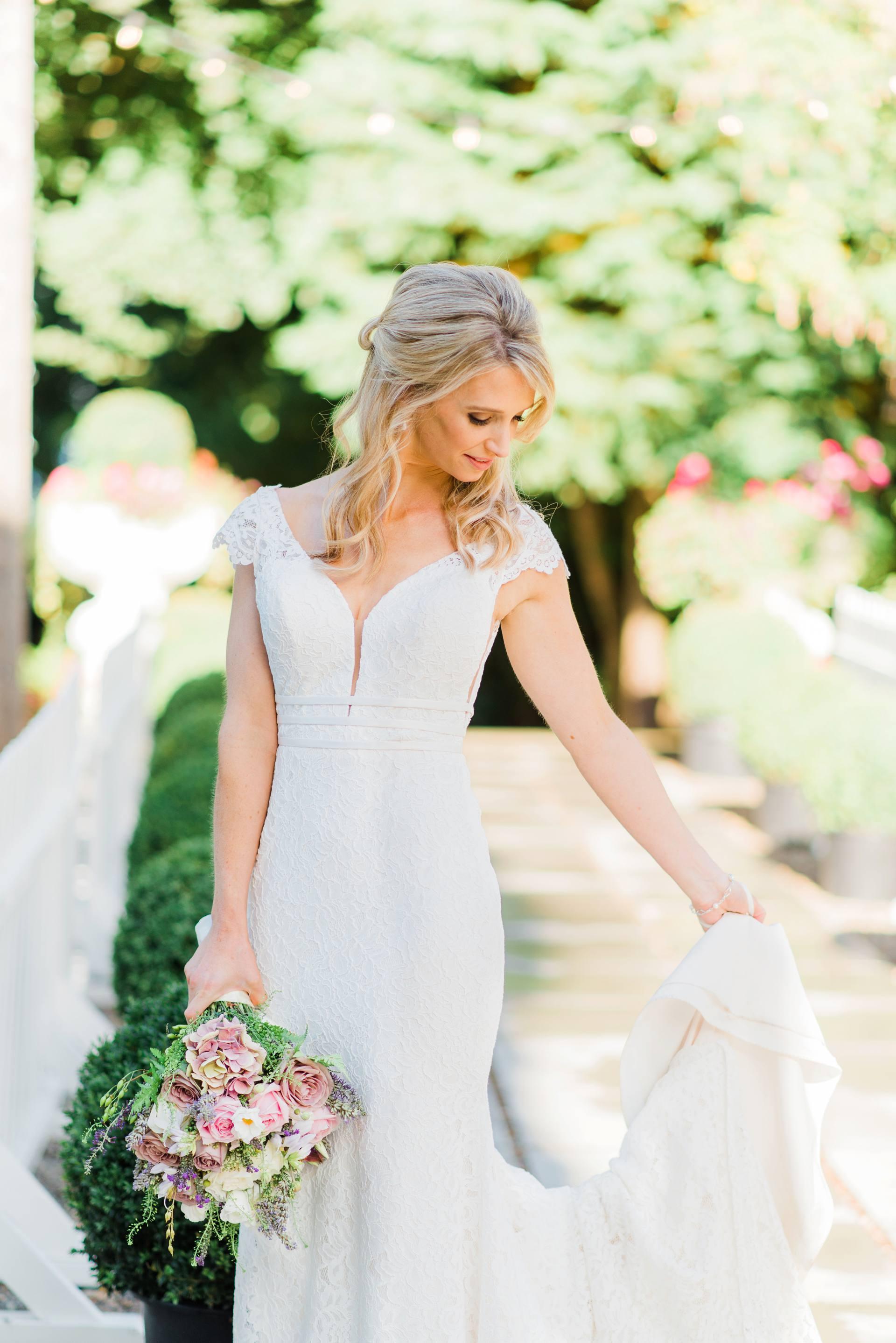 Bride holding up her wedding dress