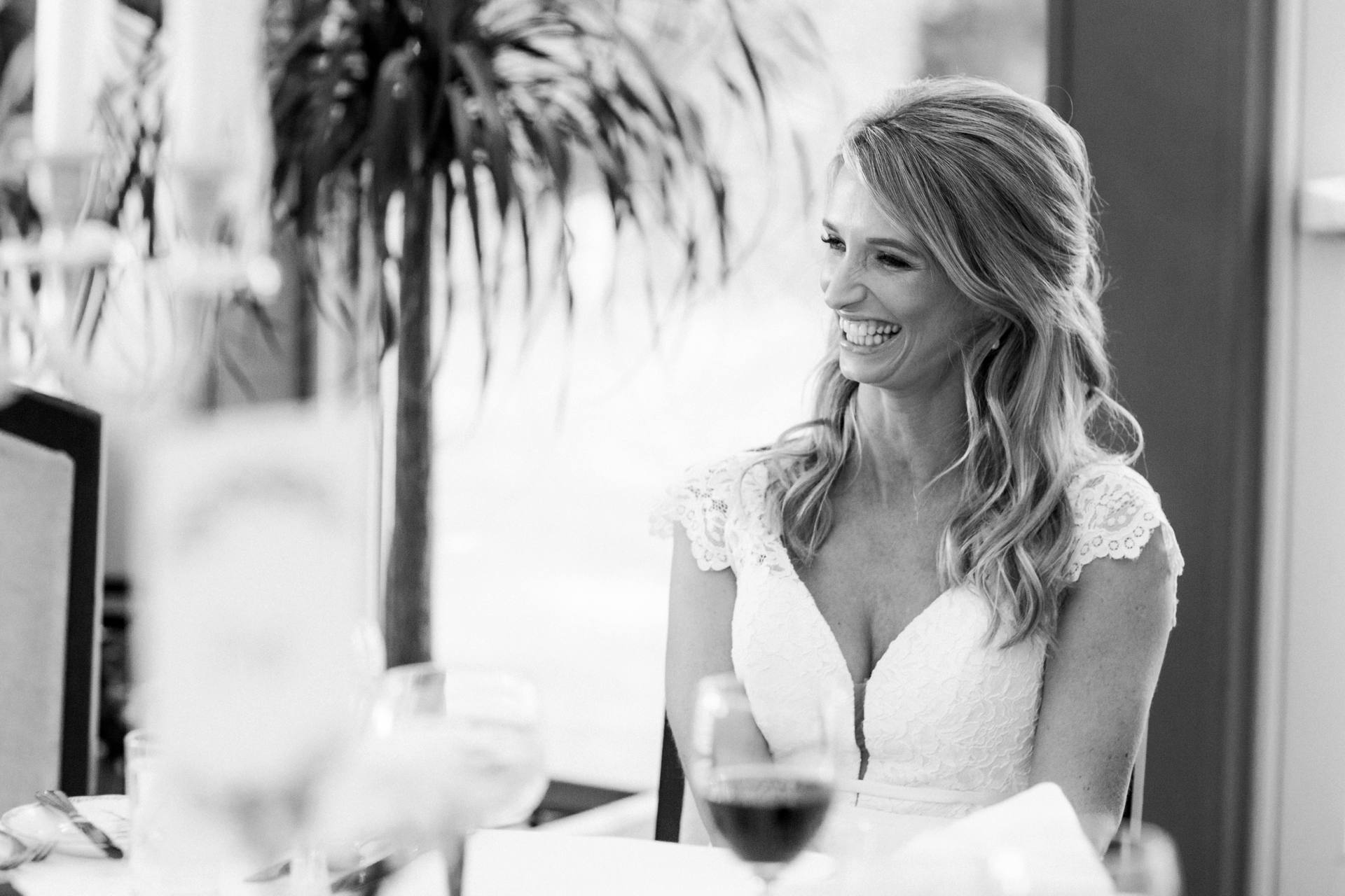 Bride laughing by herself