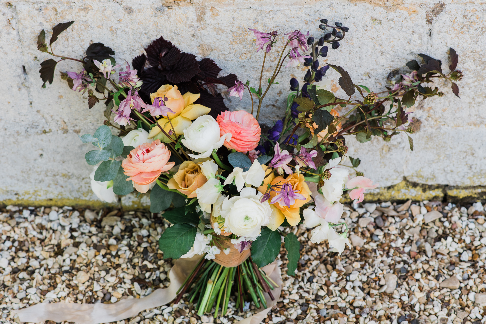 Pink, purple and yellow wedding flowers