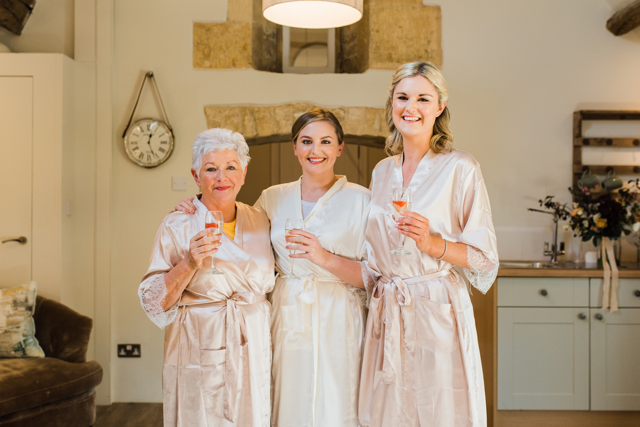 Bride with mother and bridesmaid in Lapstone Barn