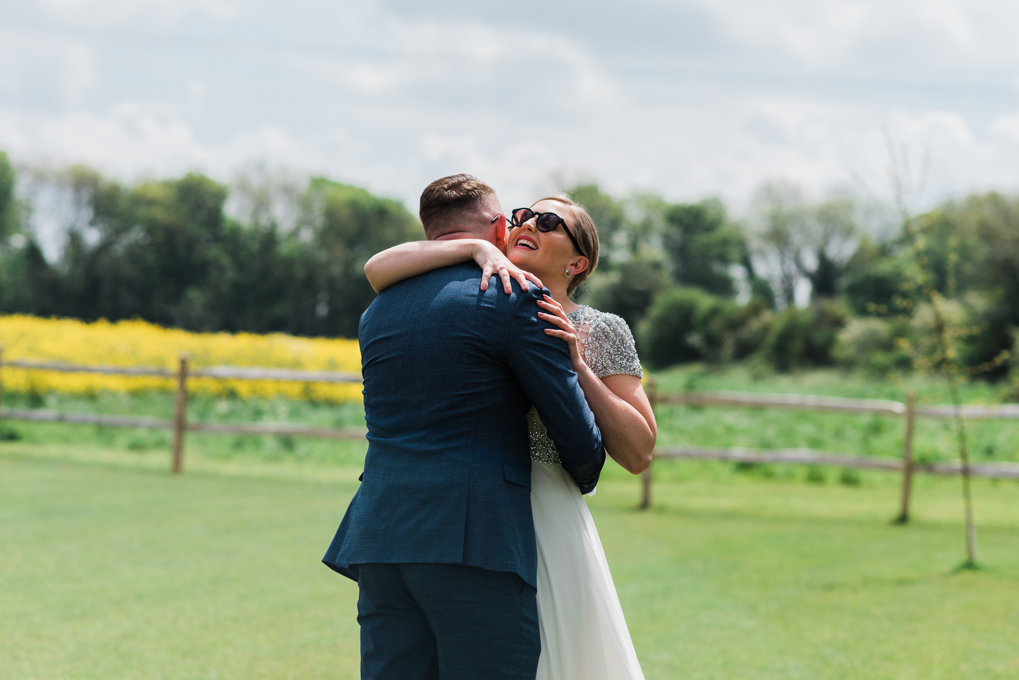 Bride and groom hugging in First Look at Lapstone Barn