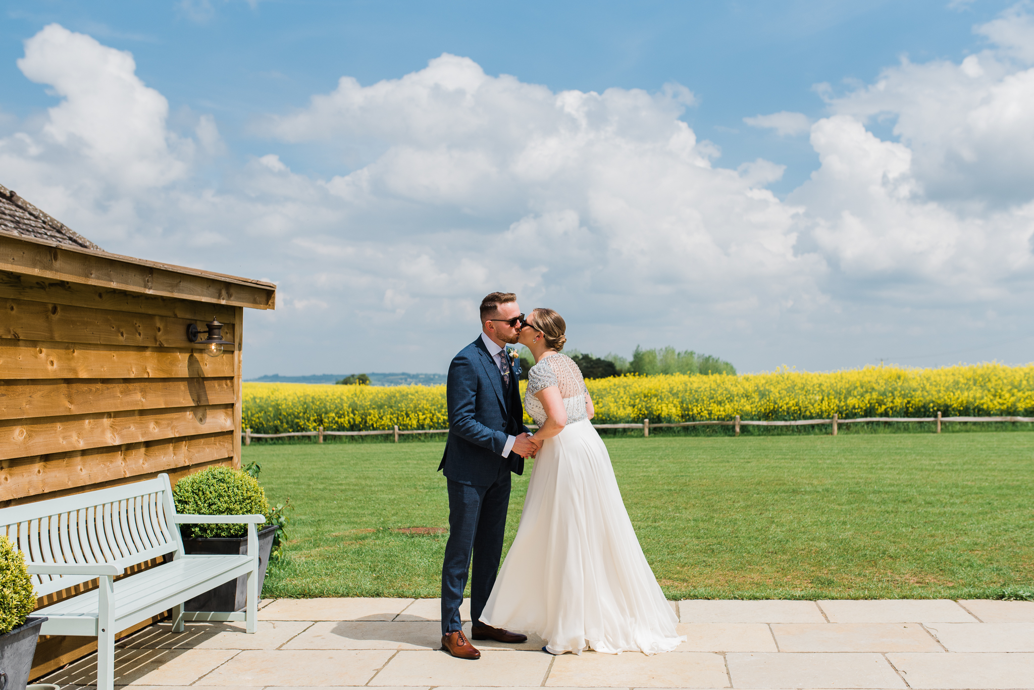 Bride and groom kissing in First Look at Lapstone Barn